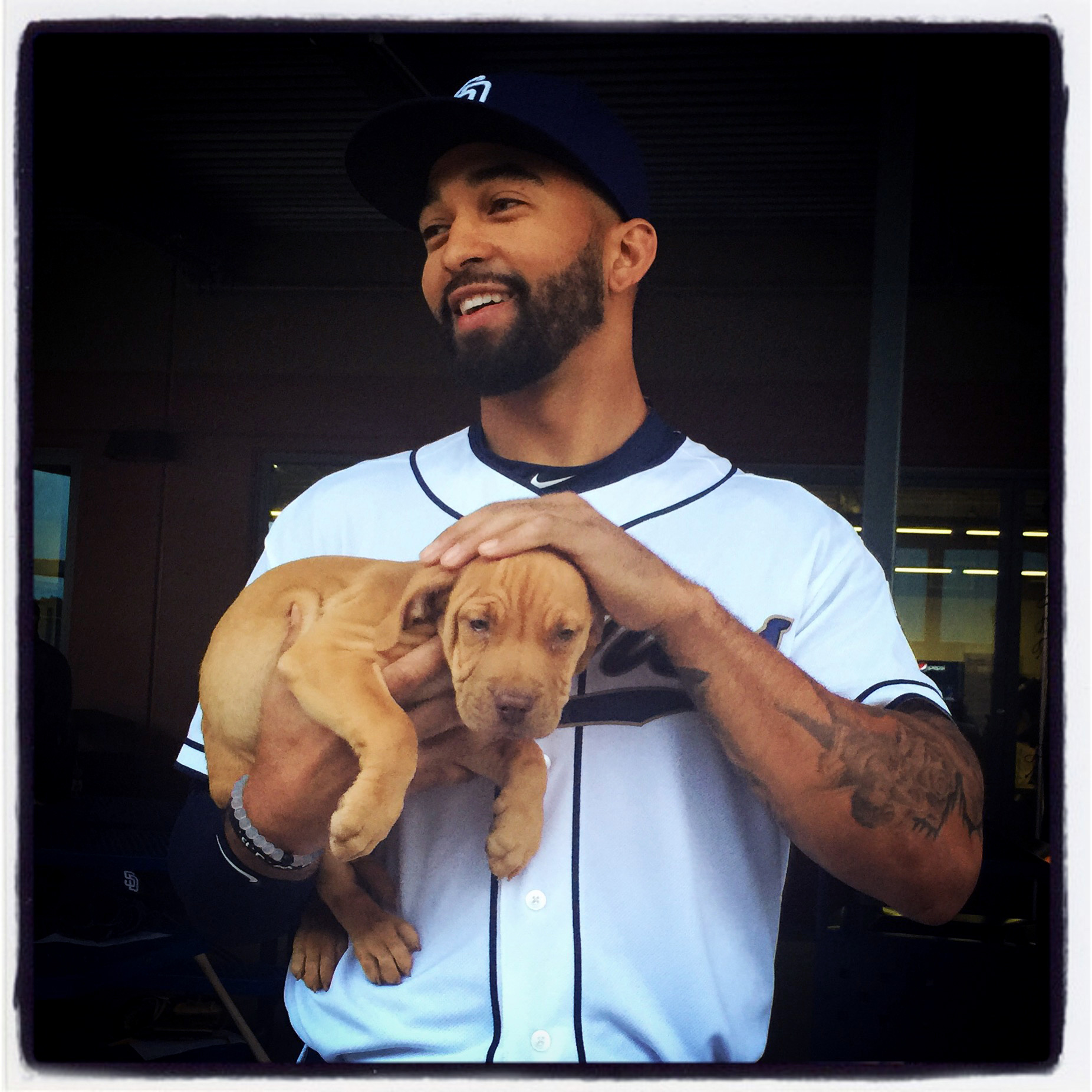 Matt Kemp of the #Padres holds his new friend on photo day this morning at #springtraining in Peoria, Arizona. #instantbaseball #iphone6plus #puppy