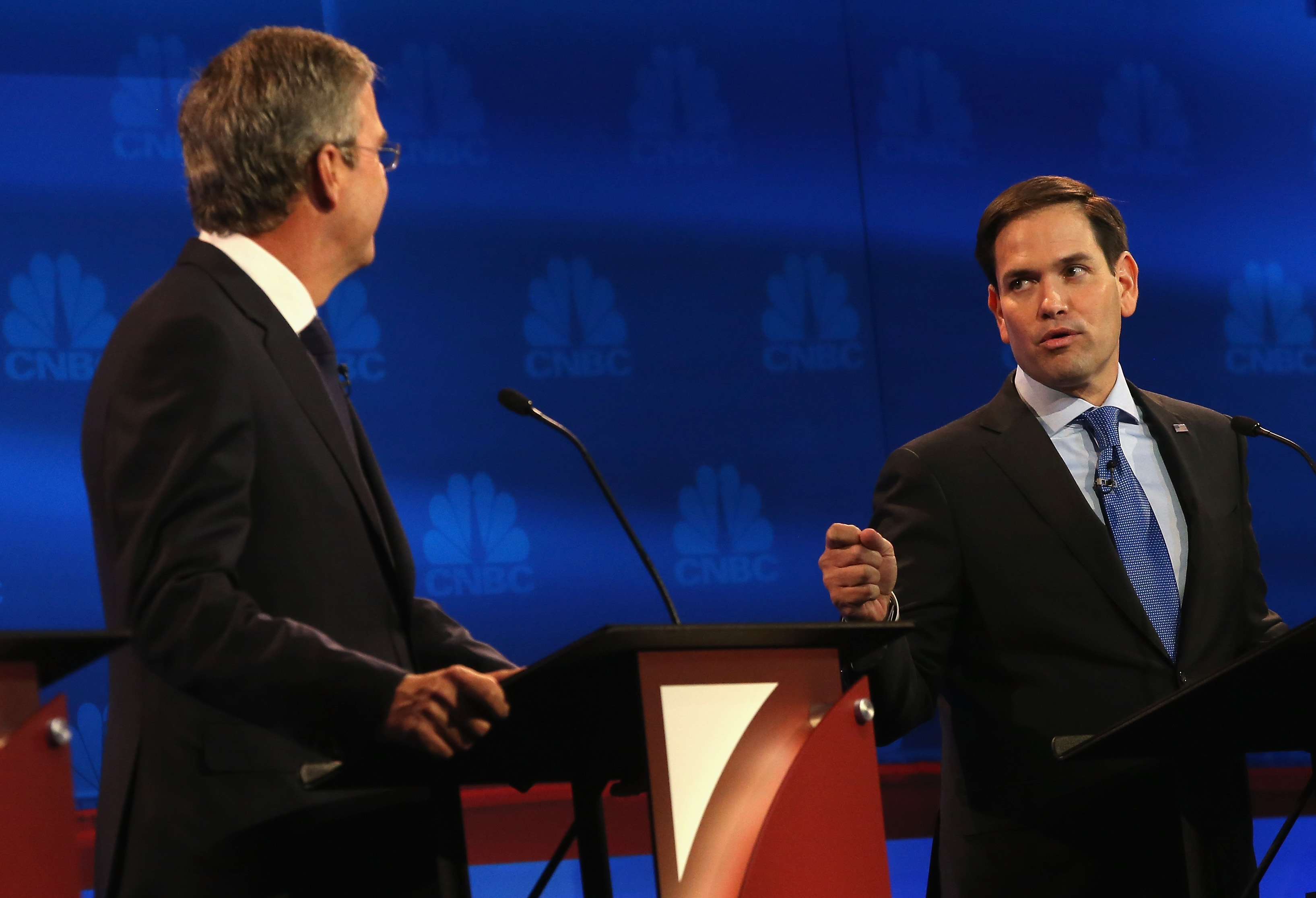 Presidential candidates Sen. Marco Rubio (R) (R-FL) speaks while Jeb Bush looks on during the CNBC Republican Presidential Debate in Boulder, Colorado on Oct. 28, 2015 .