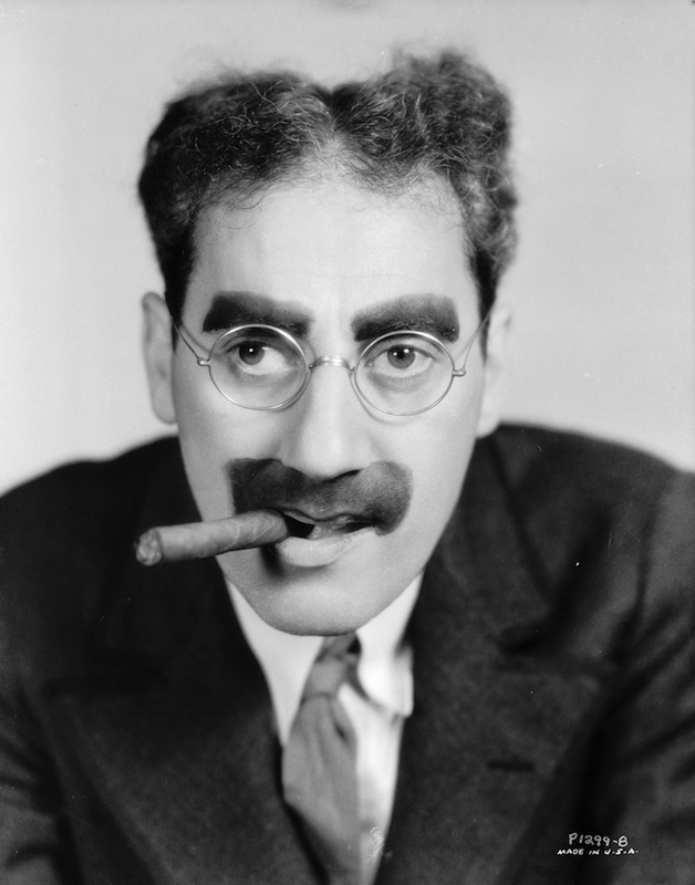 circa 1935:  American actor Groucho Marx (1890 - 1977), with his trademark moustache and glasses.