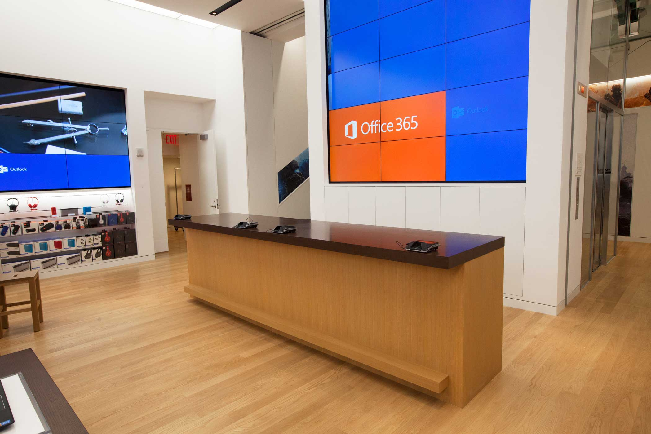 <b>Microsoft Store</b> A help desk and checkout counter.