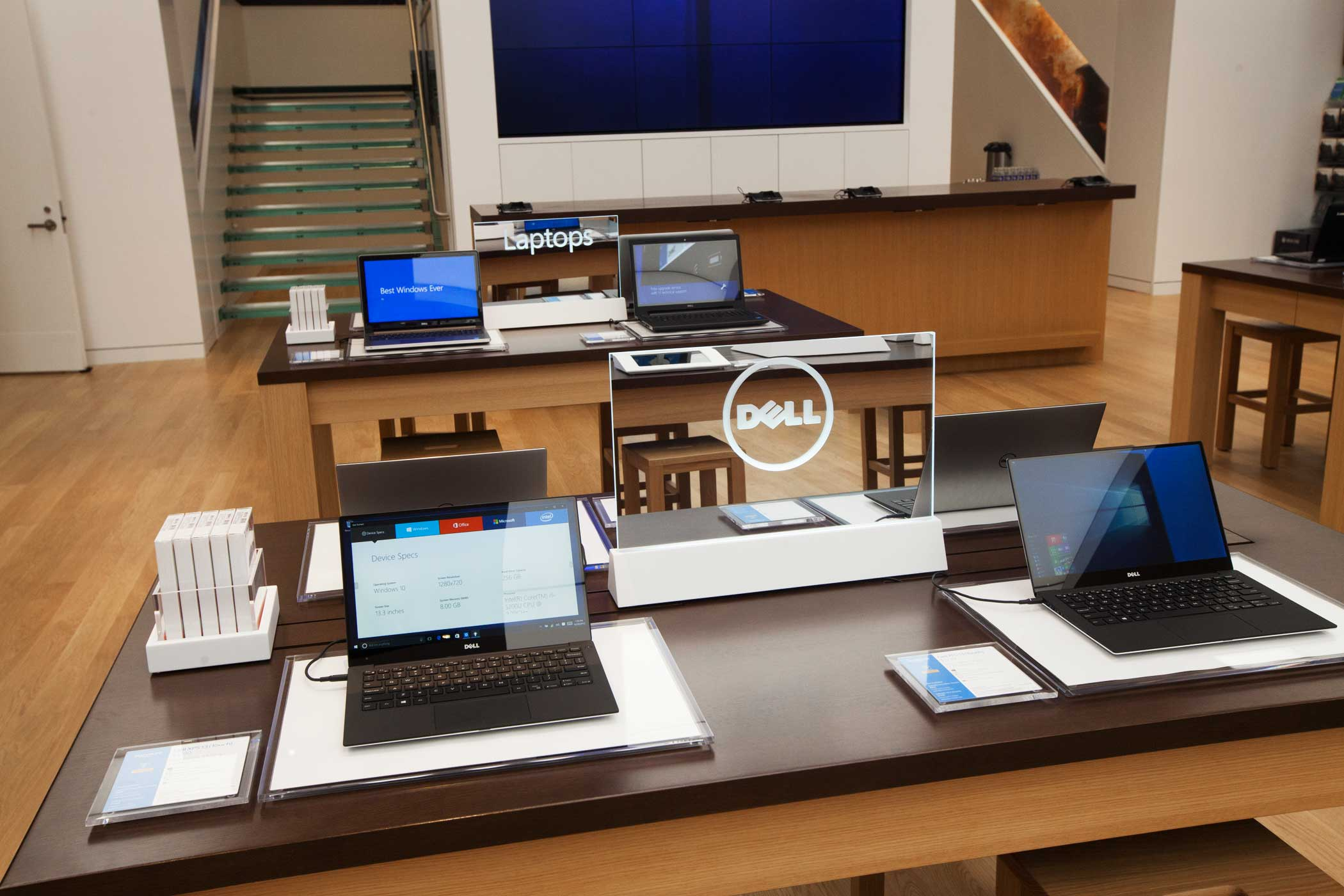 <b>Microsoft Store</b> Dell computers are on sale with other laptops behind them.