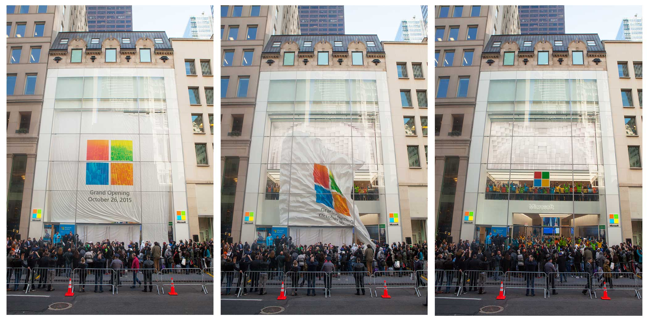 The flag covering Microsoft's Flagship Store is dropped as the store opens to the public on Oct. 26, 2015.