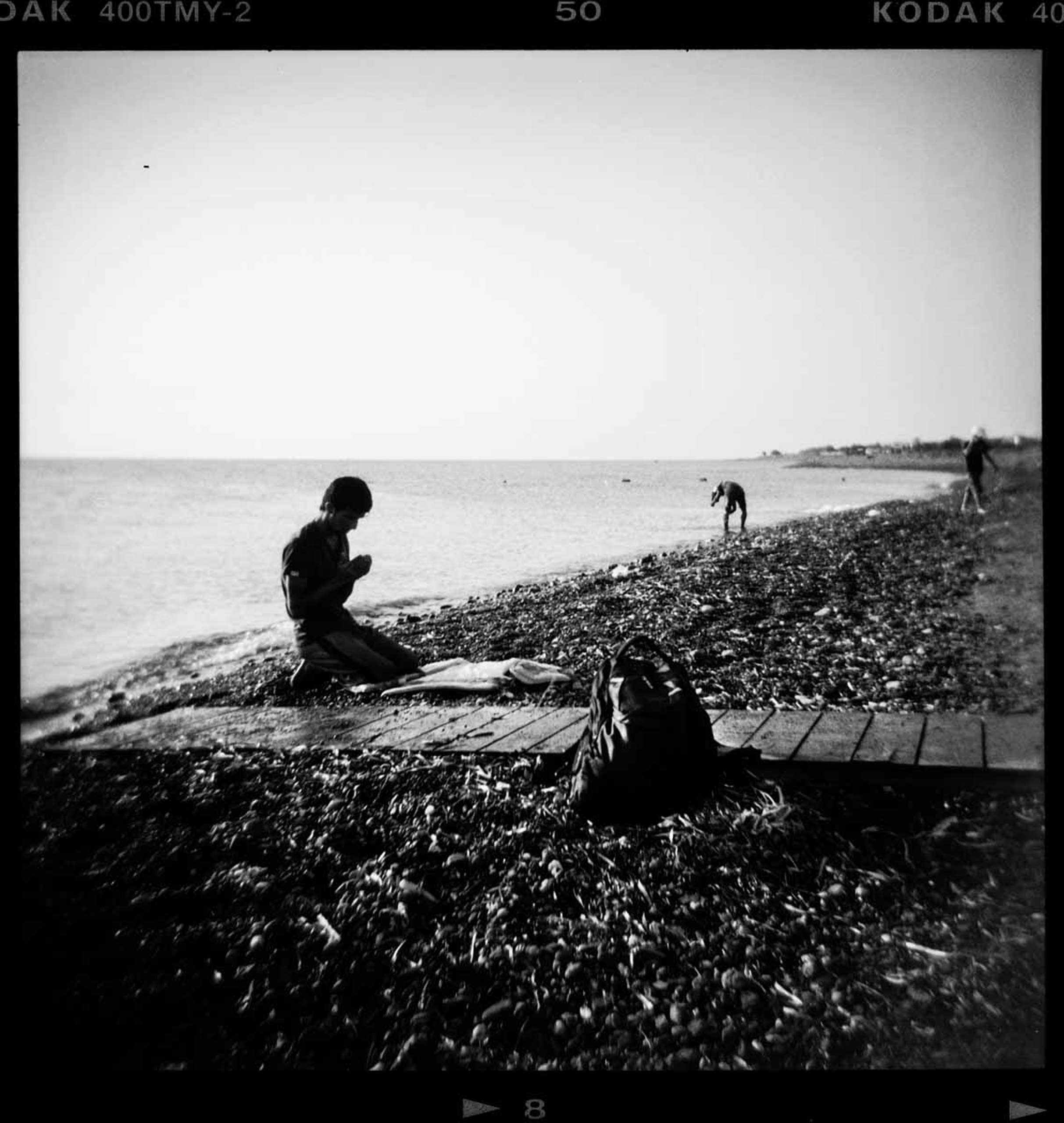 Al Jazeera English: The Unpromised LandA refugee prays moments after he arrived in a dinghy on Psalidi beach on the Greek island of Kos, on Aug. 2015.