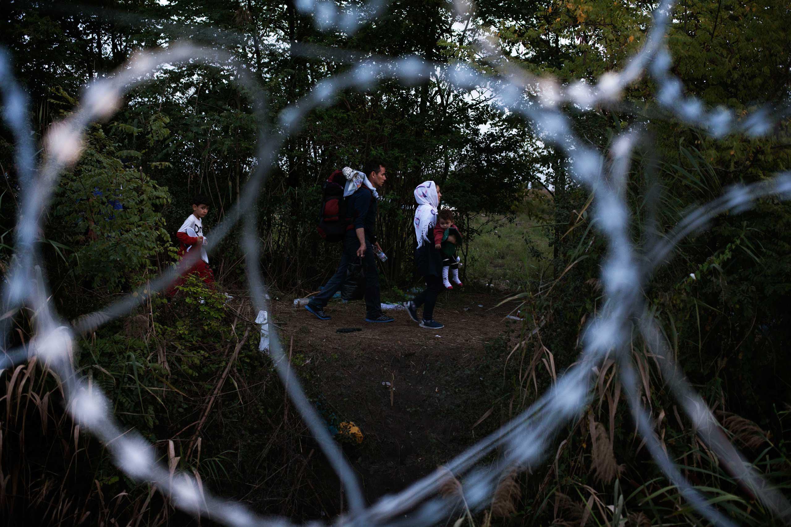 Le Monde: Europe's Locked DoorsA family walks near the Serbia-Hungary border, on Sept. 14, 2015.