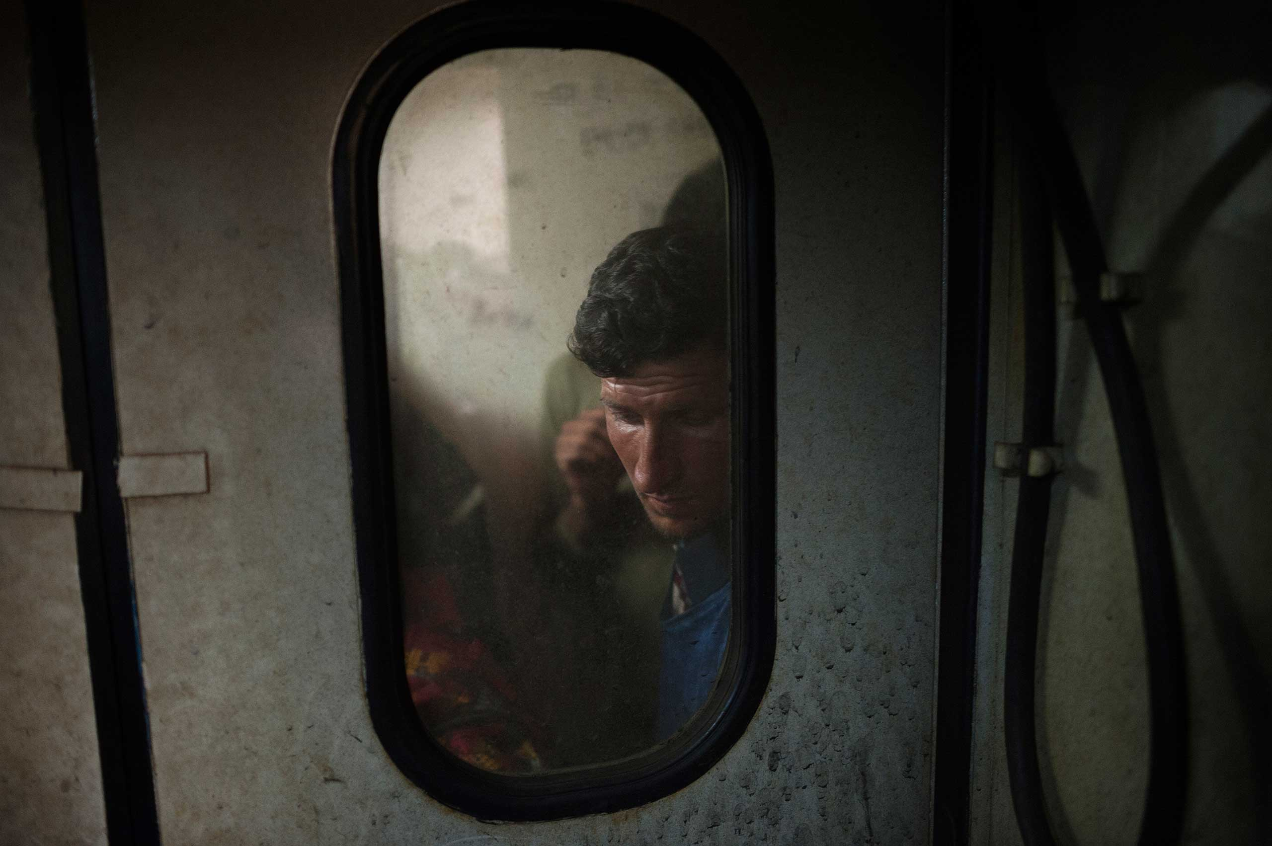The New York Times Lens blog: Photographing Europe's Migrant Crisis, Year After Year                               Afghan and Pakistani migrants traveling on a train started from Belgrade, Serbia, toward Subotica, the arrival point of most migrants trying to cross the border between Serbia and Hungary, on July 14, 2015.                                Ph.Giulio Piscitelli