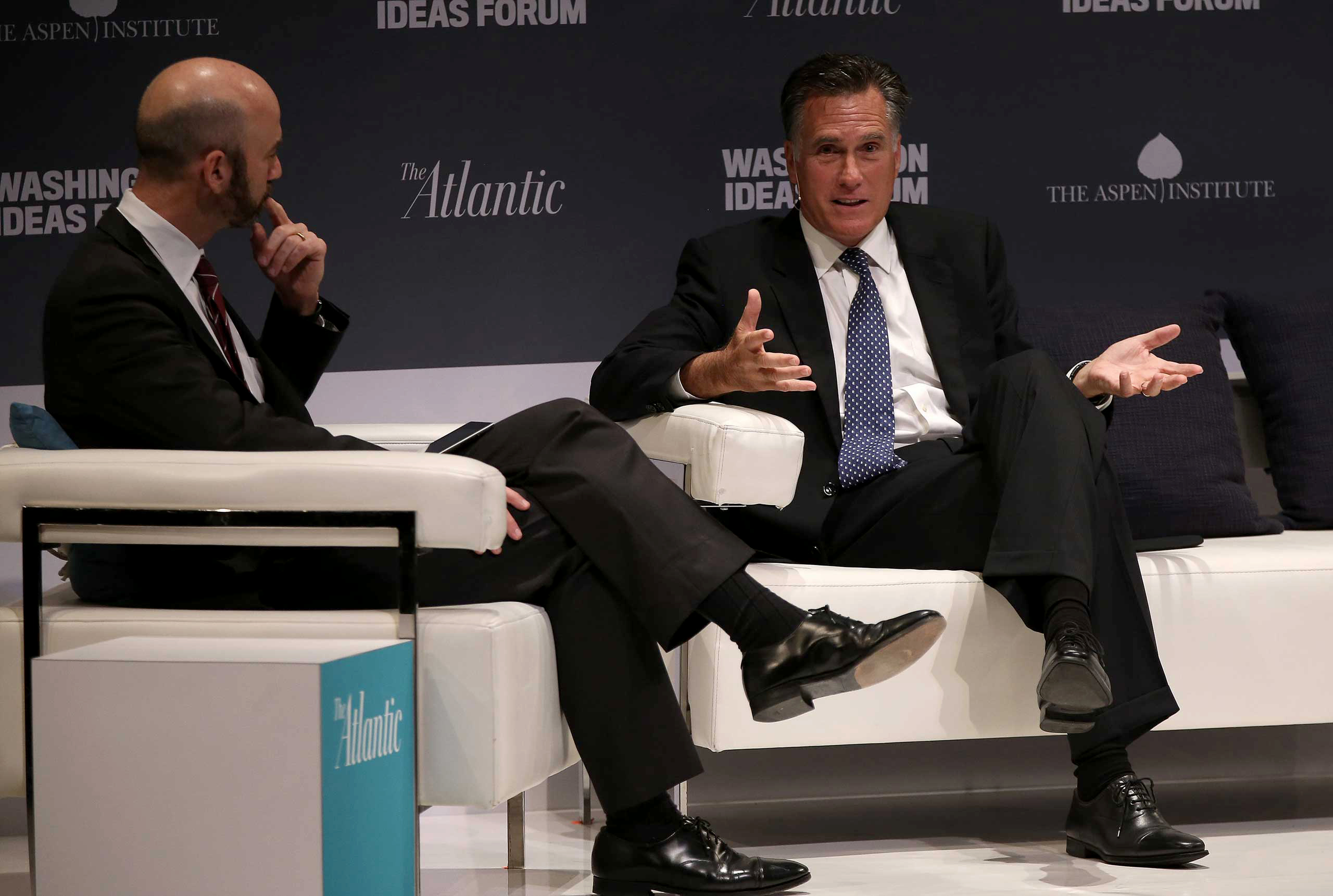 Former Republican presidential candidate Mitt Romney (R) speaks at the Washington Ideas Forum with James Bennet (L), of The Atlantic, in Washington, DC., Sept. 30, 2015.