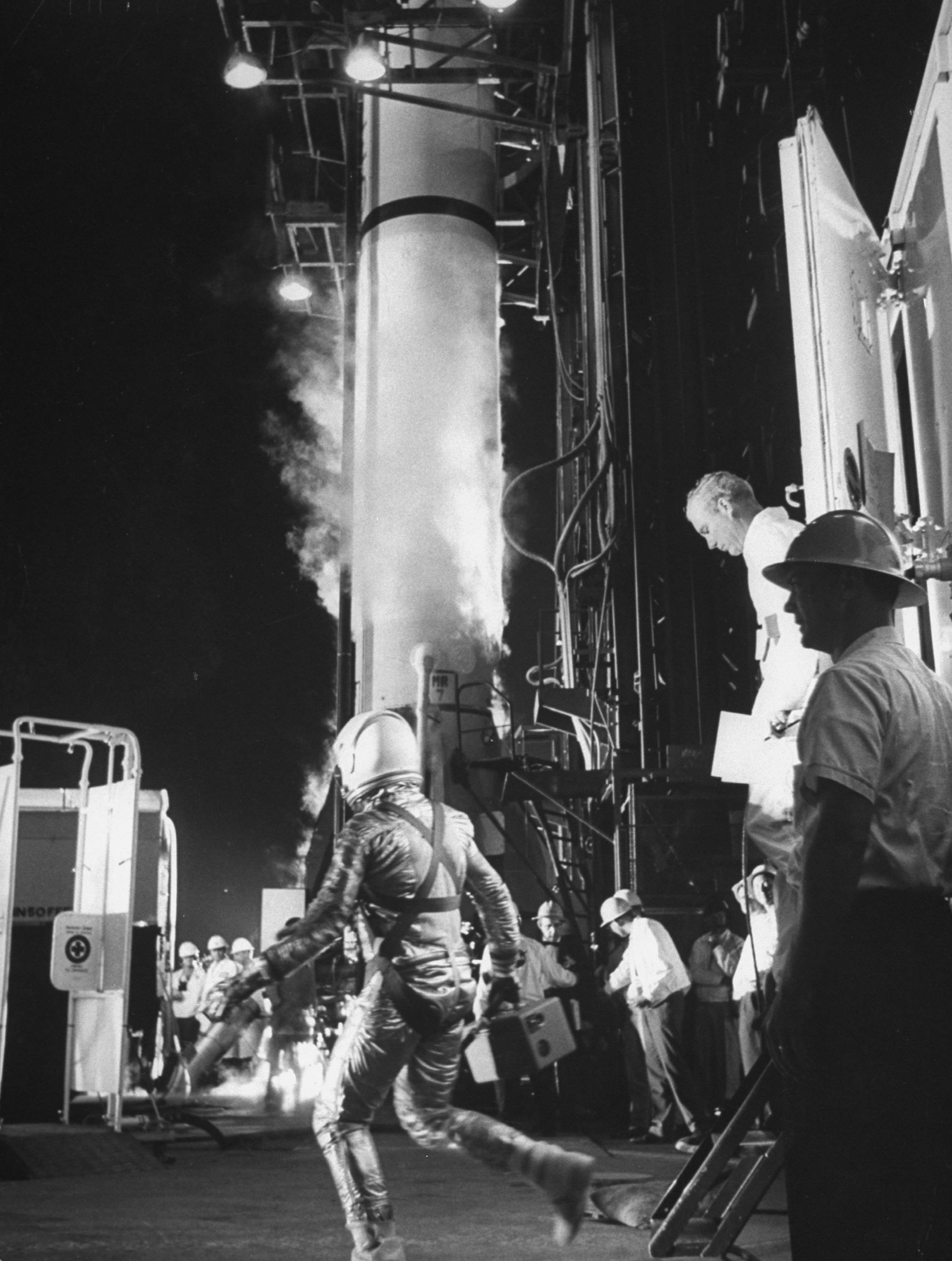 <b>Alan Shepard at the Launchpad, 1961</b>; Alan Shepard strides toward his vessel, Freedom 7, to be first American into space.