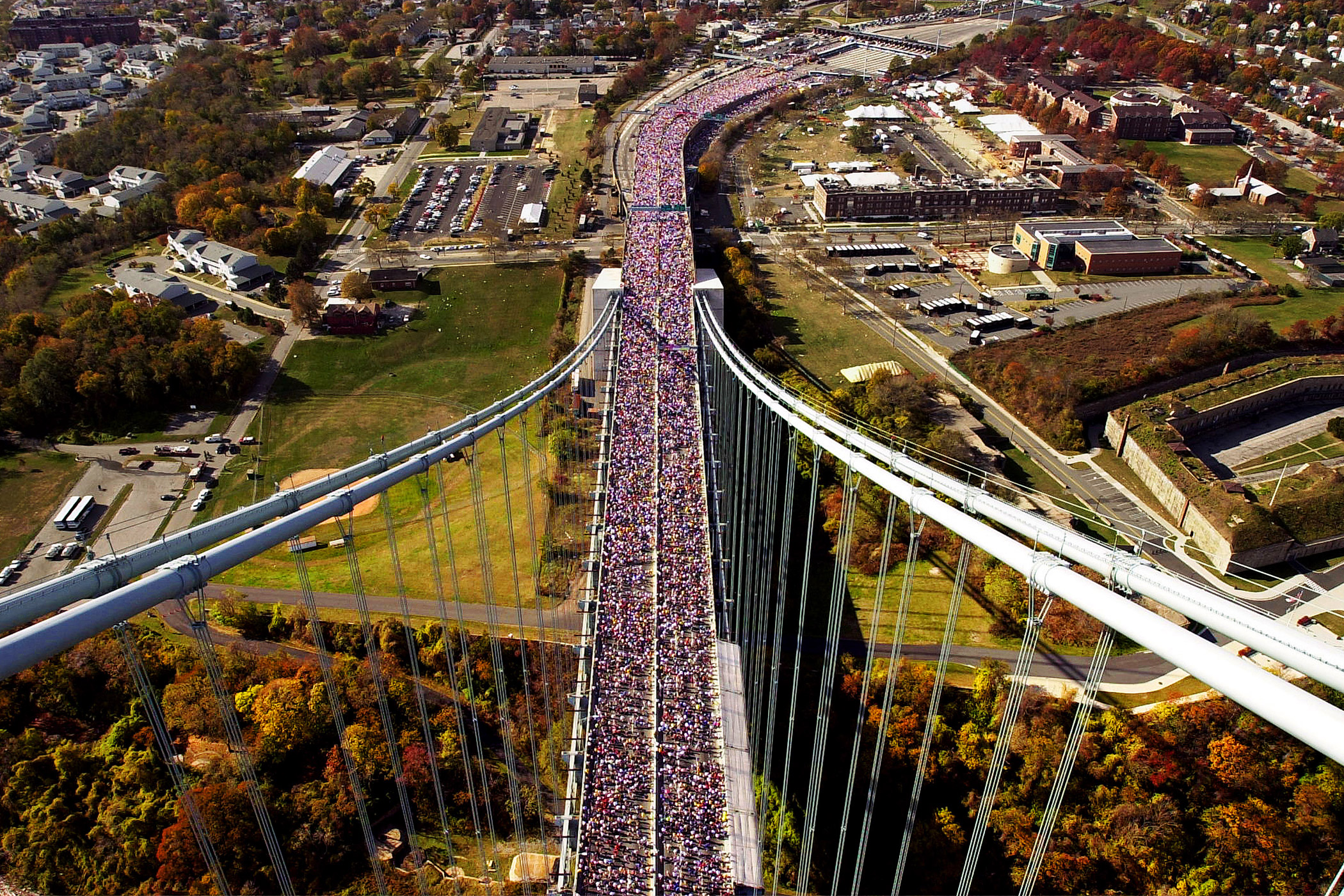 Runners make their way across the Verrazano Narrows Bridge in New York at the start of the New York City Marathon on Nov. 5, 2000.