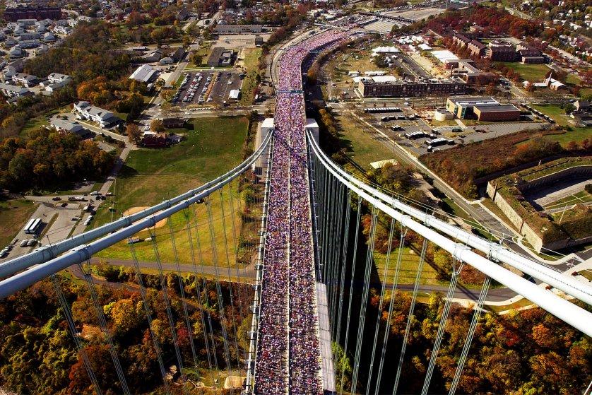 Runners make their way across the Verrazano Narrows Bridge in New York at the start of the New York City Marathon on Nov. 5, 2000.