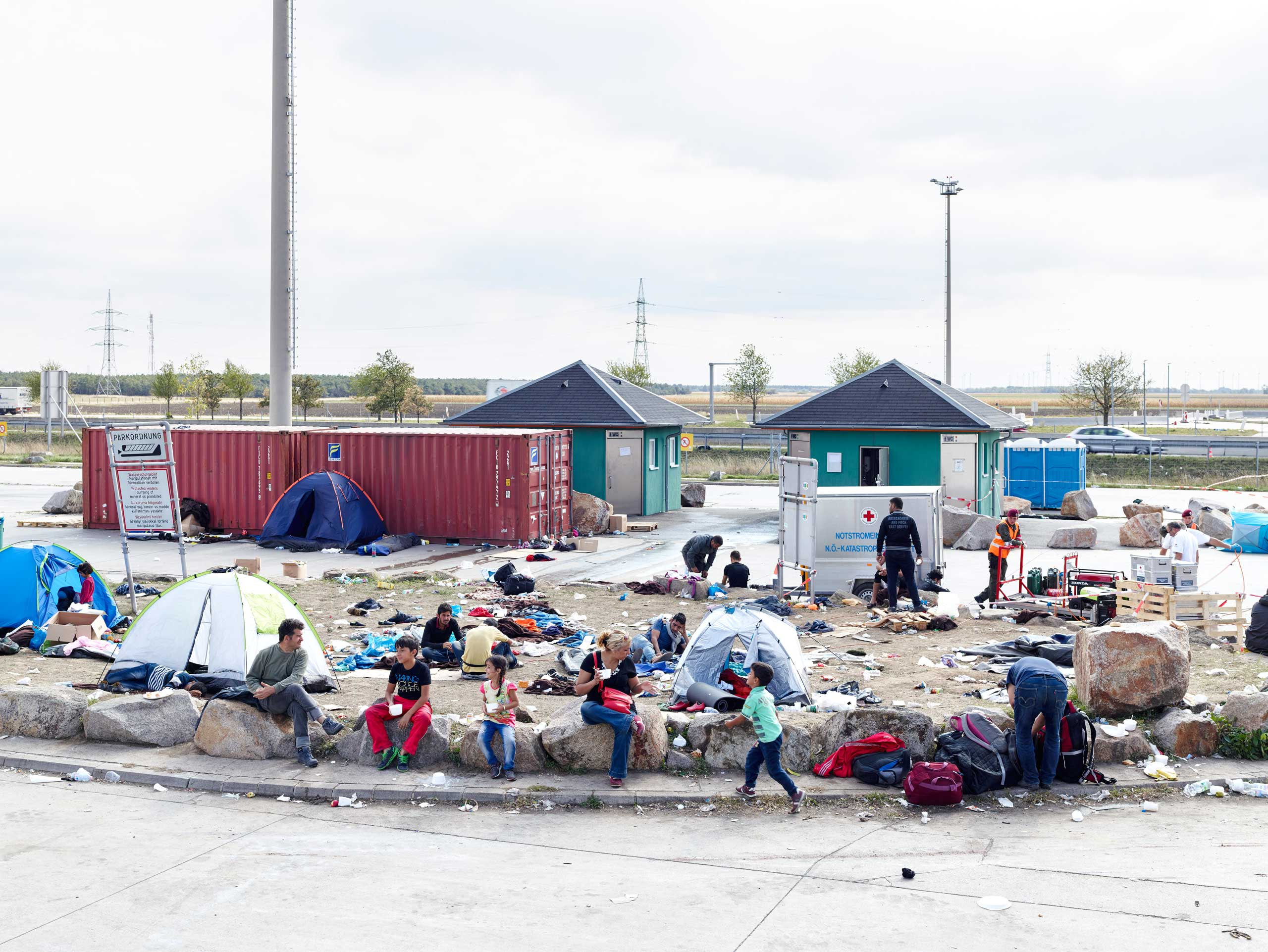 Refugees wait in Nickelsdorf, Austria, on the Hungary border, a major entry point for migrants from the Middle East.