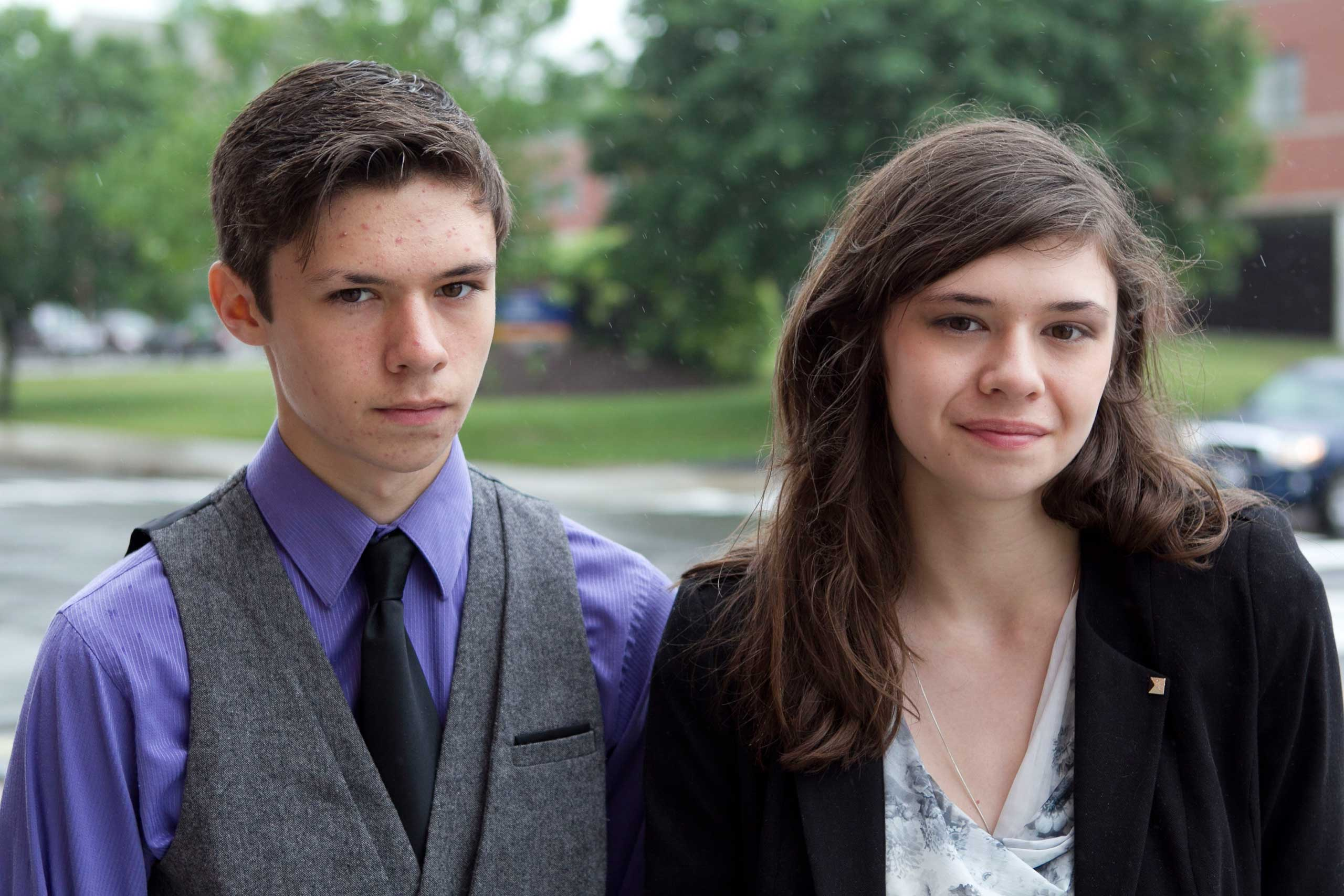 Jonas Maines, left, and his transgender sister, Nicole Maines, stand outside the Penobscot Judicial Center, in Bangor, Maine, June 12, 2013.