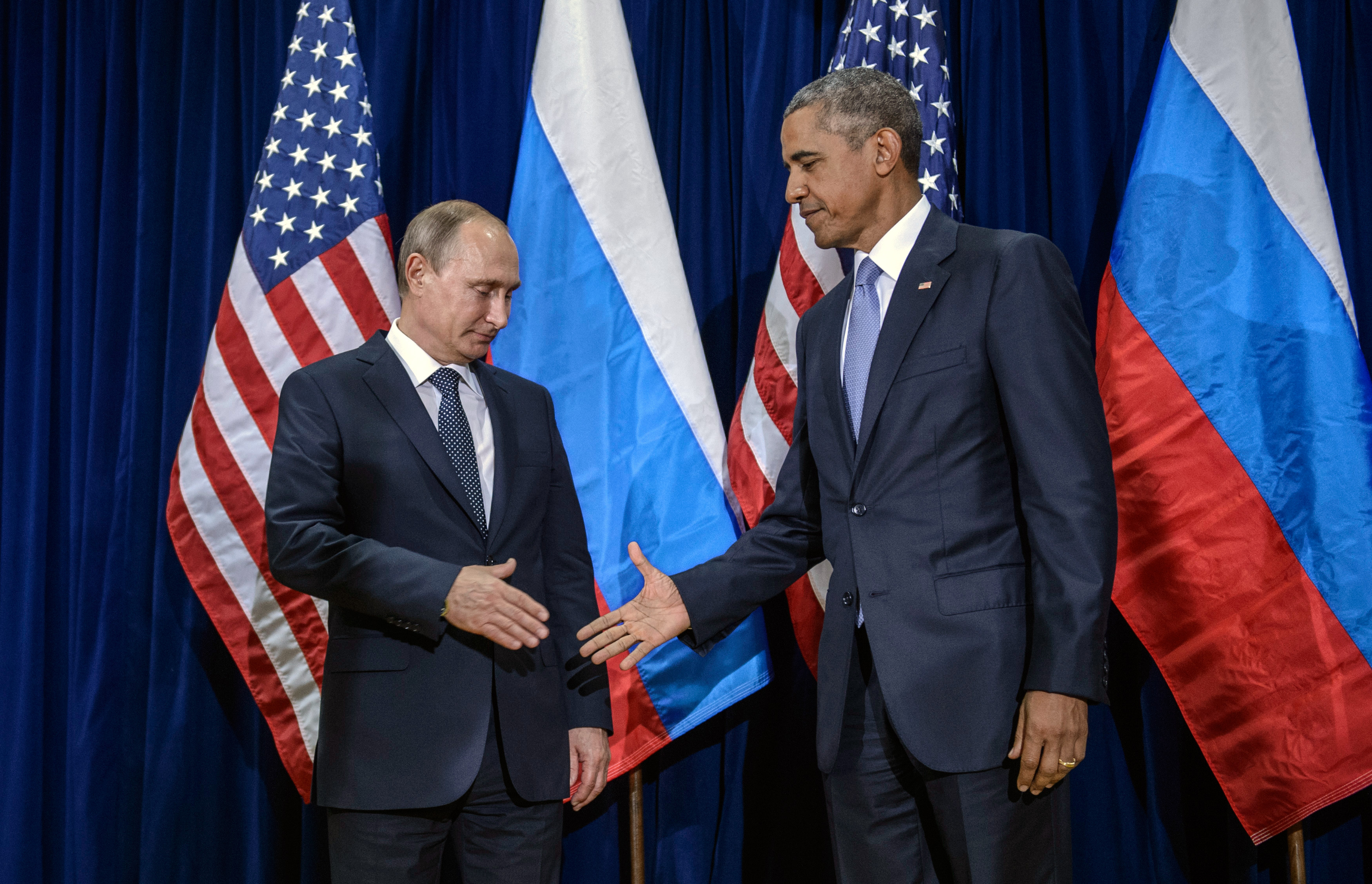 Russian President Vladimir Putin (L) and U.S. President Barack Obama shake hands for the cameras before the start of a bilateral meeting at the United Nations headquarters  in New York City on Sept. 28, 2015.