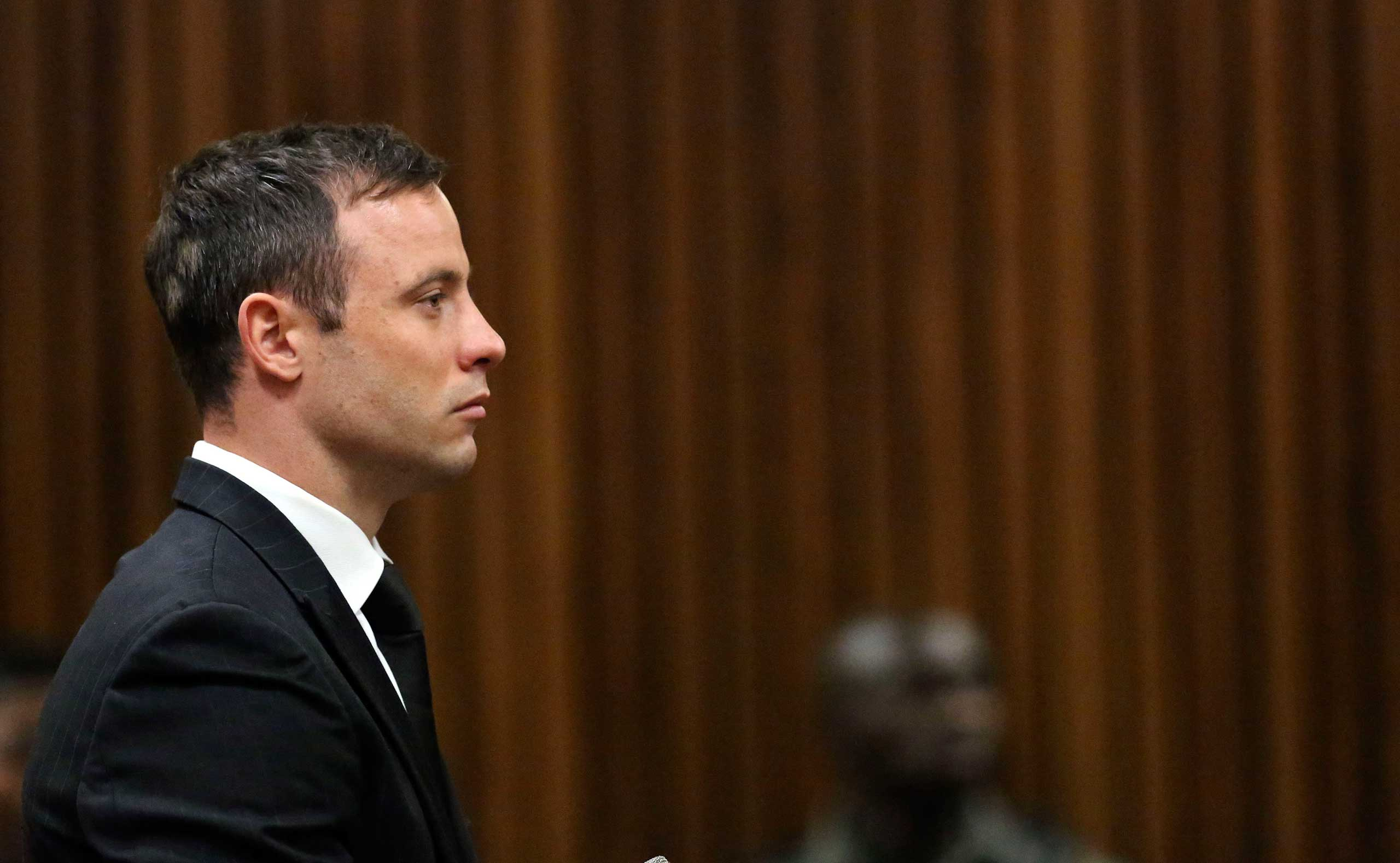South African Olympic and Paralympic track star Oscar Pistorius attends his sentencing at the North Gauteng High Court in Pretoria Oct. 21, 2014.