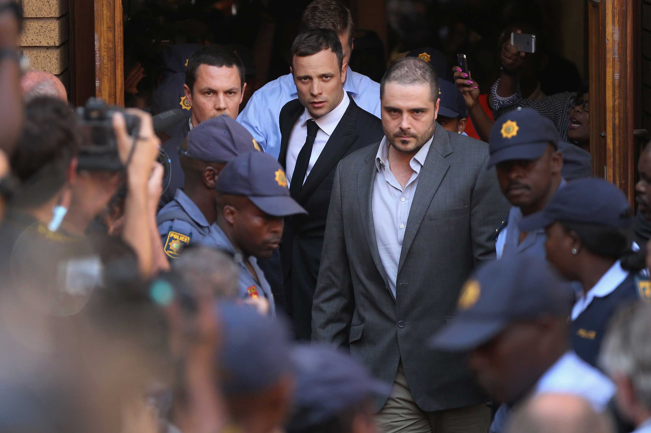 Oscar Pistorius leaves North Gauteng High Court in Pretoria, South Africa, on Sept. 11, 2014.