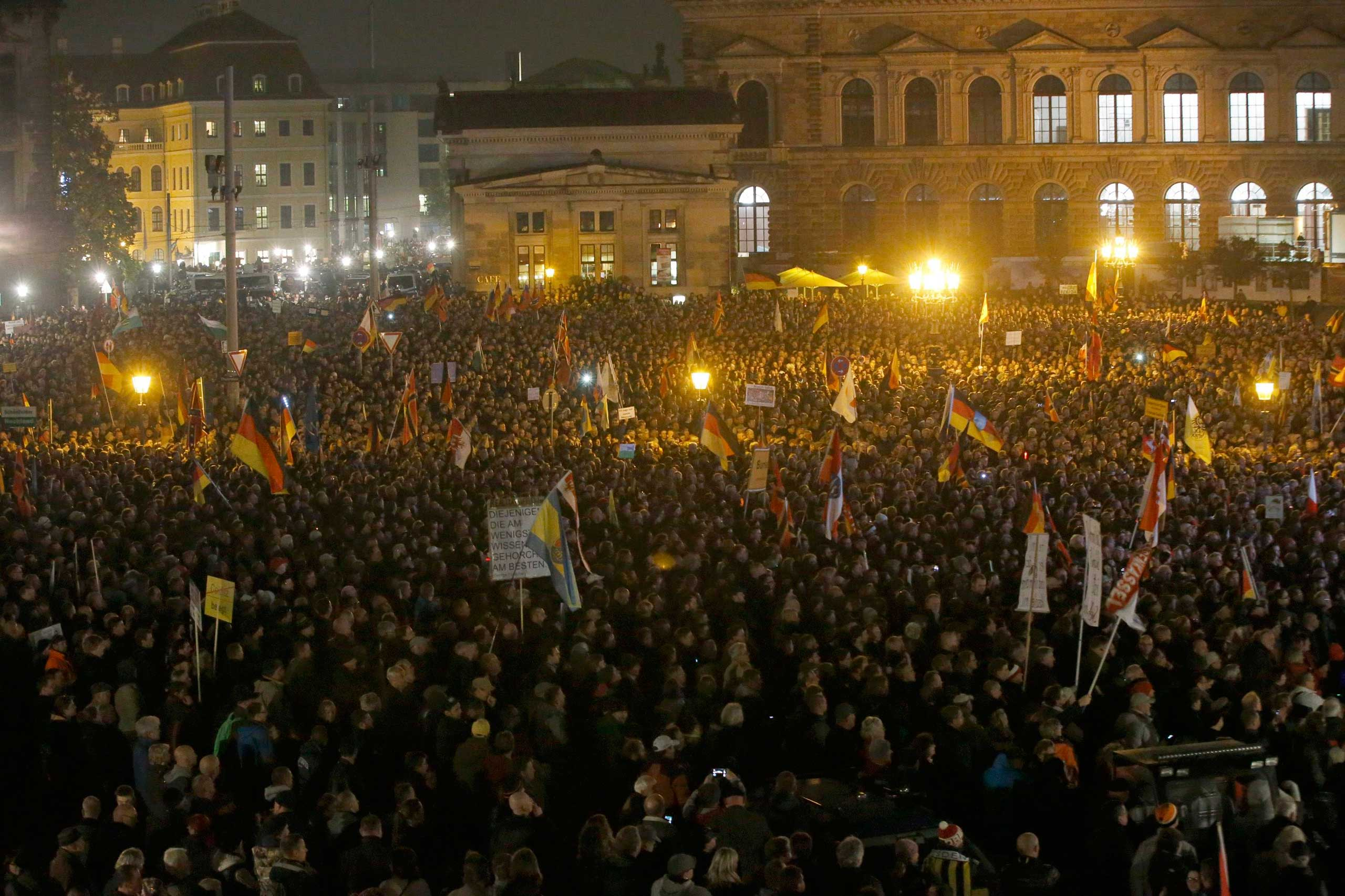 People gather for an anti-immigration demonstration organised by rightwing movement Patriotic Europeans Against the Islamisation of the West (PEGIDA) in Dresden, Germany, on Oct. 19, 2015.