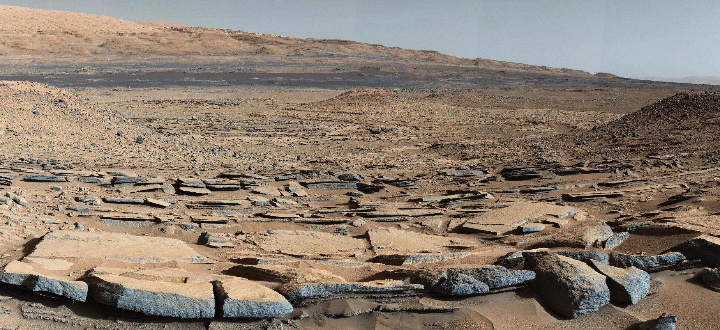 This image released on Oct. 8, 2015 shows a view from the  Kimberley  formation on Mars taken by NASA's Curiosity rover. The strata in the foreground dip towards the base of Mount Sharp, indicating flow of water toward a basin that existed before the larger bulk of the mountain formed.