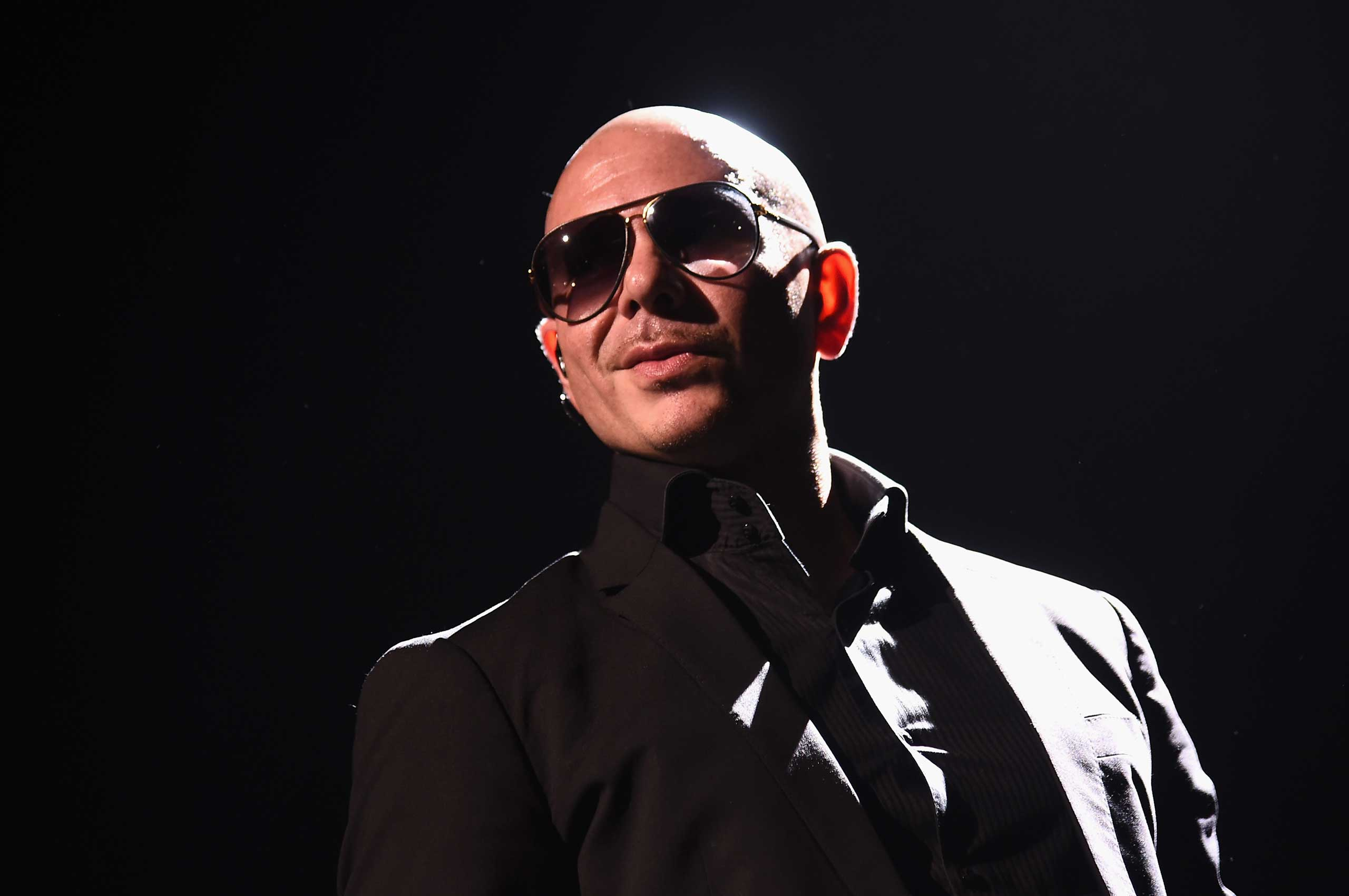 Artist Pitbull performs onstage in New York City, July 19, 2015.