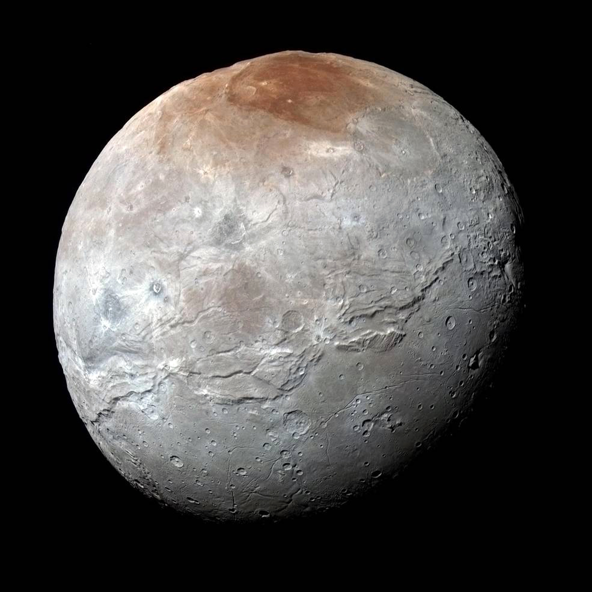 This image released by NASA on Thursday, Oct. 1, 2015, shows Charon, in enhanced color by captured by NASA's New Horizons captured just before closest approach on July 14, 2015.