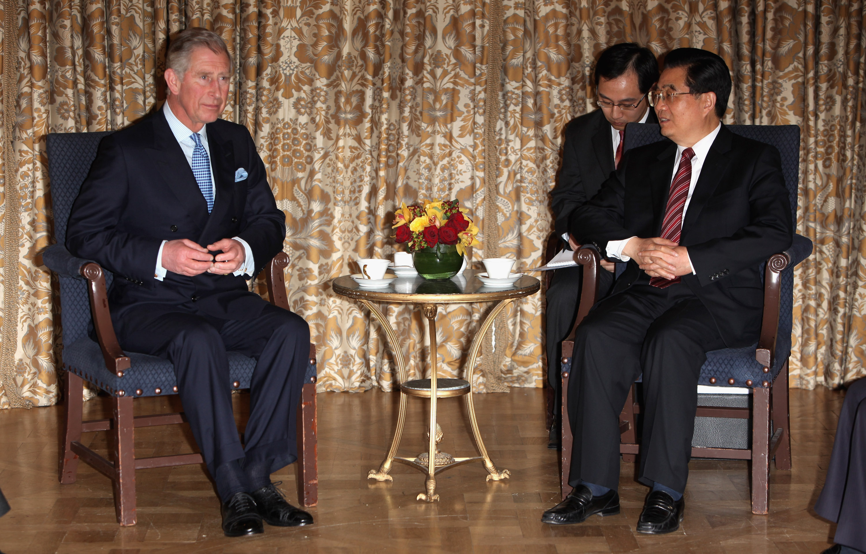 The Prince of Wales, left, speaks with then Chinese President Hu Jintao on April 2, 2009, in London
