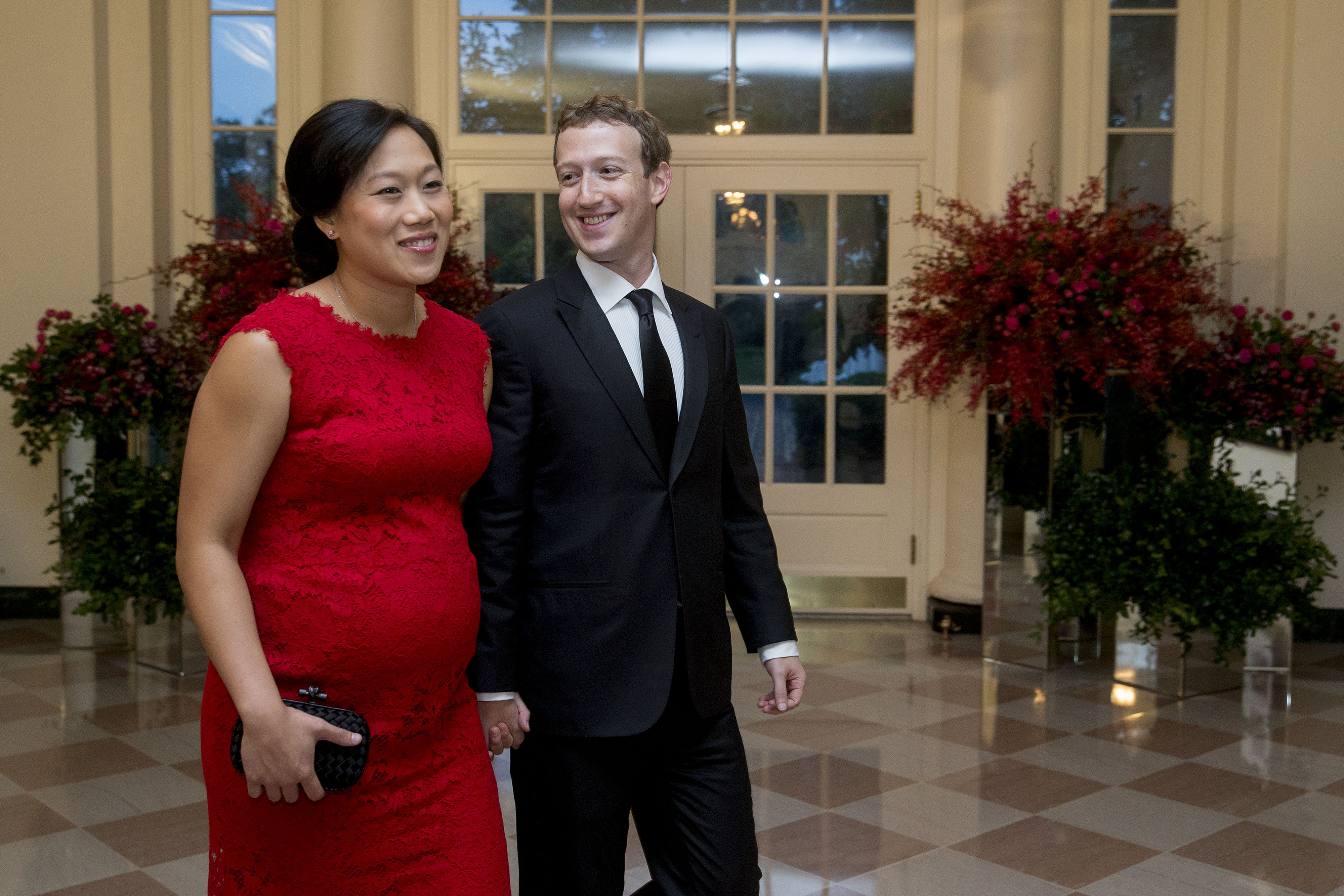 Priscilla Chan and Mark Zuckerberg arrive at a state dinner at the White House in Washington, D.C. on Sept. 25, 2015.