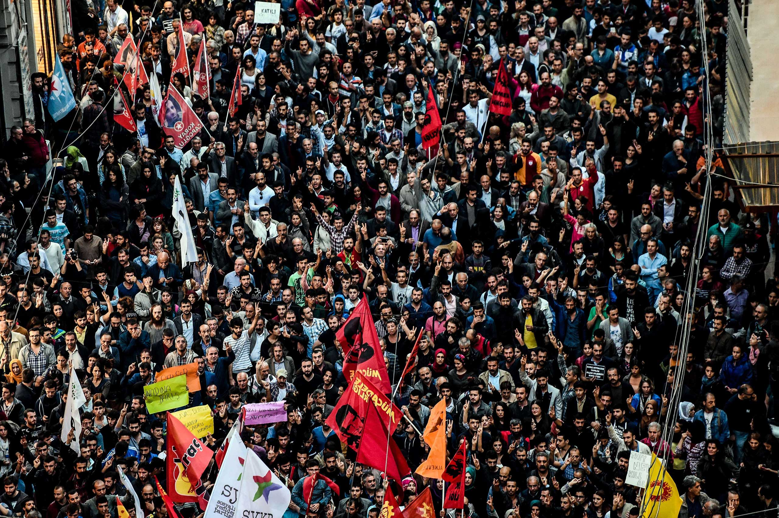 Thousands of protesters take part in a march against the deadly attack earlier in Ankara on Oct. 10, 2015 at the Istiklal avenue in Istanbul.