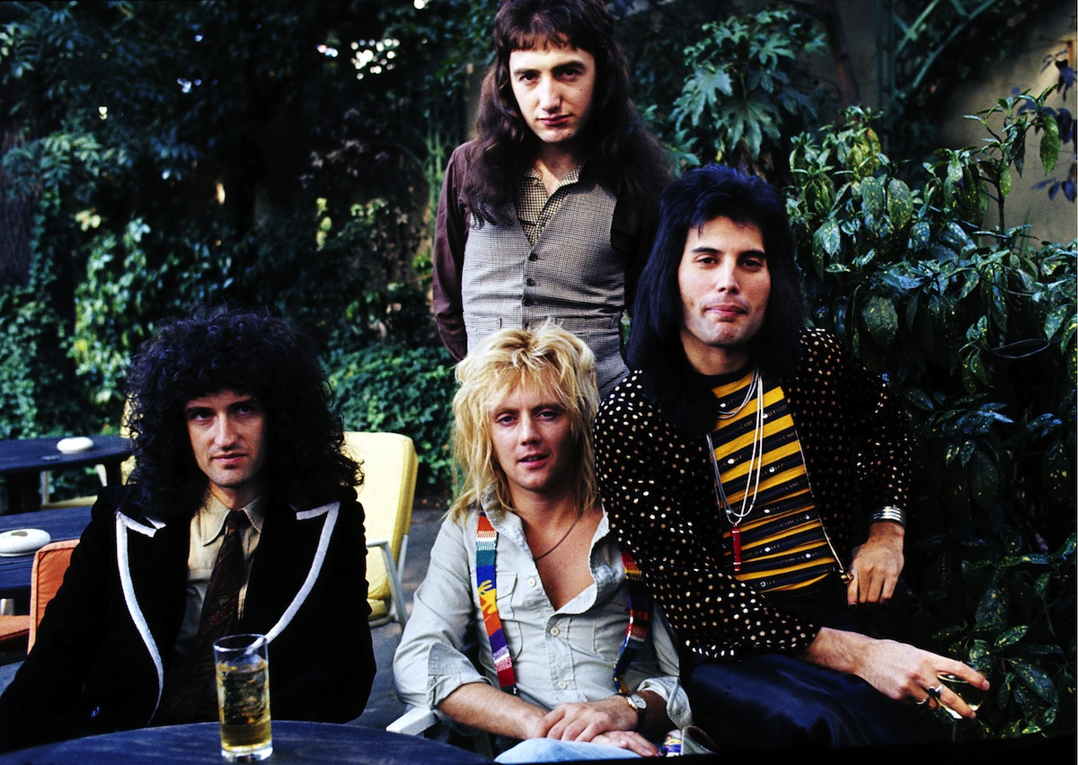 (L-R) Brian May, John Deacon (standing), Roger Taylor and Freddie Mercury of British rock group Queen at Les Ambassadeurs where they were presented with silver, gold and platinum discs for sales in excess of one million of their hit single 'Bohemian Rhapsody', which was No 1 for 9 weeks, on Sept. 8, 1976 in London