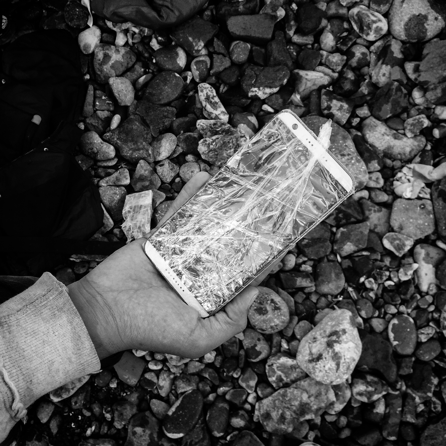 A cellphone protected by plastic. Lesbos, Greece.