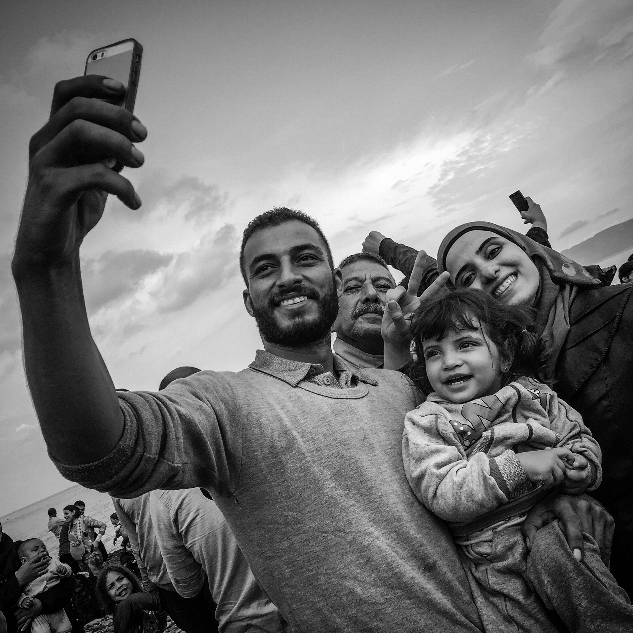 Refugees take a selfie after arriving on the island of Lesbos in Greece.