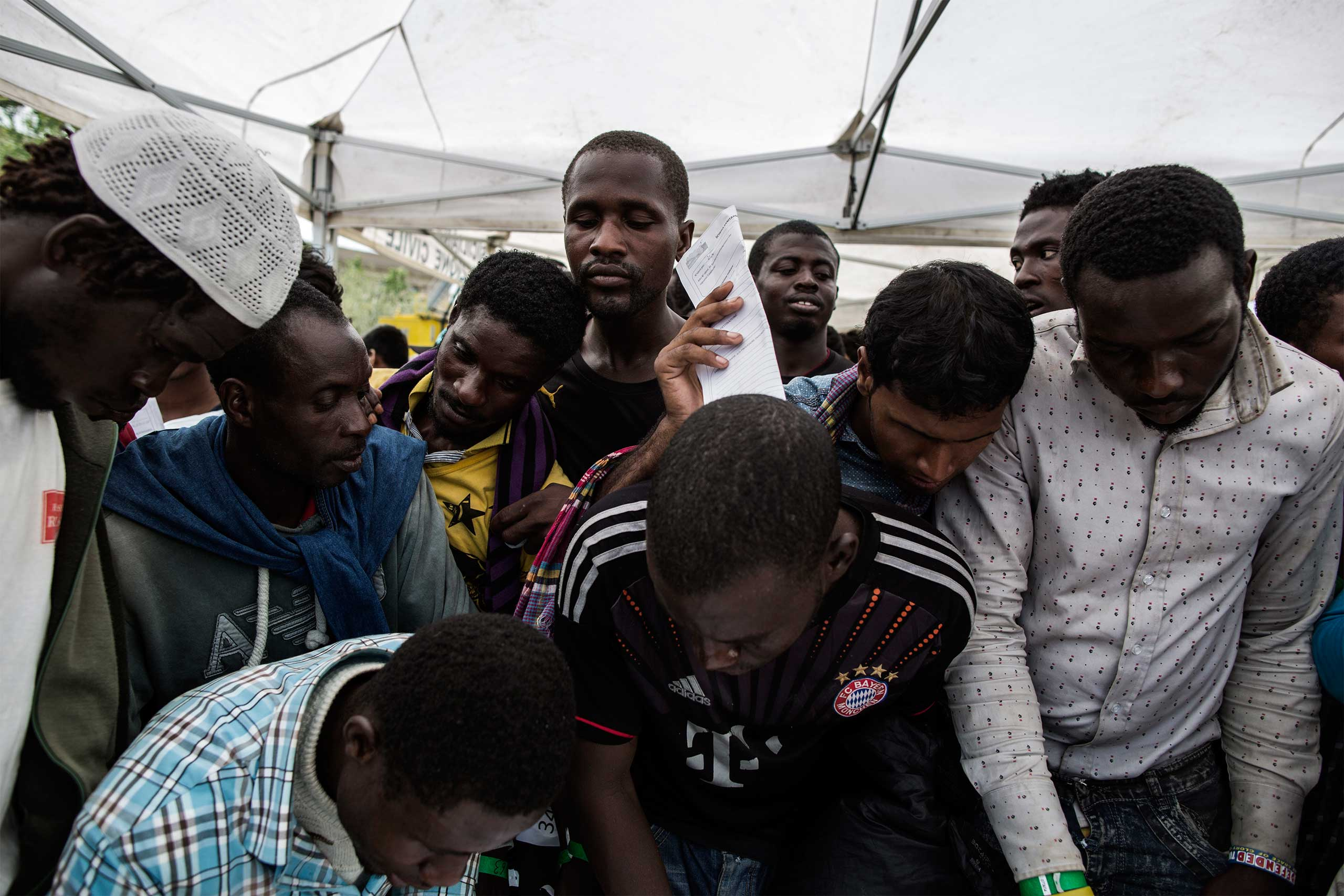 African migrants and refugeesregister in the town of Messina, Sicily.  July 2015.