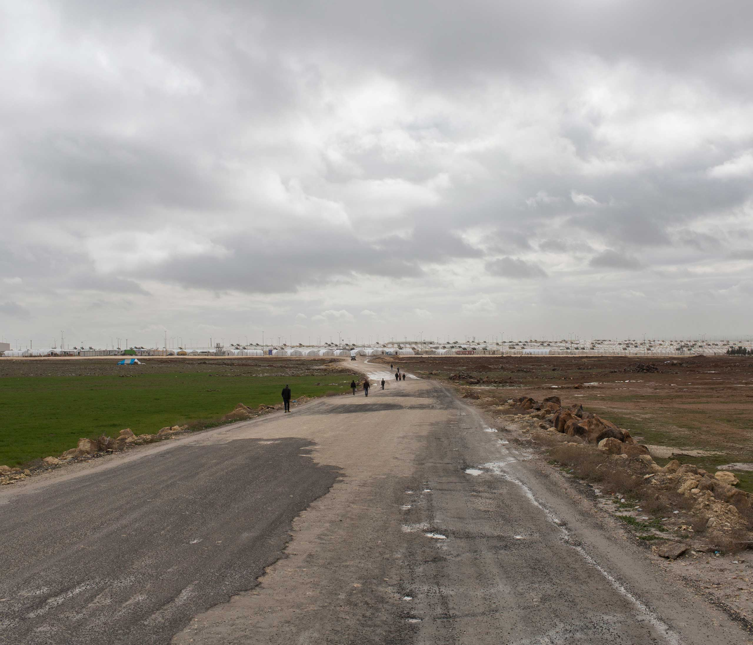 Syrian refugees file in and out of Suruc camp in the South East of Turkey near the border with Syria. Built in the wake of the massive influx of mainly Kurdish Syrian refugees from the nearby Syrian city of Kobane, it is Turkey's largest camp with a capacity of over 30,000. Feb. 2015.