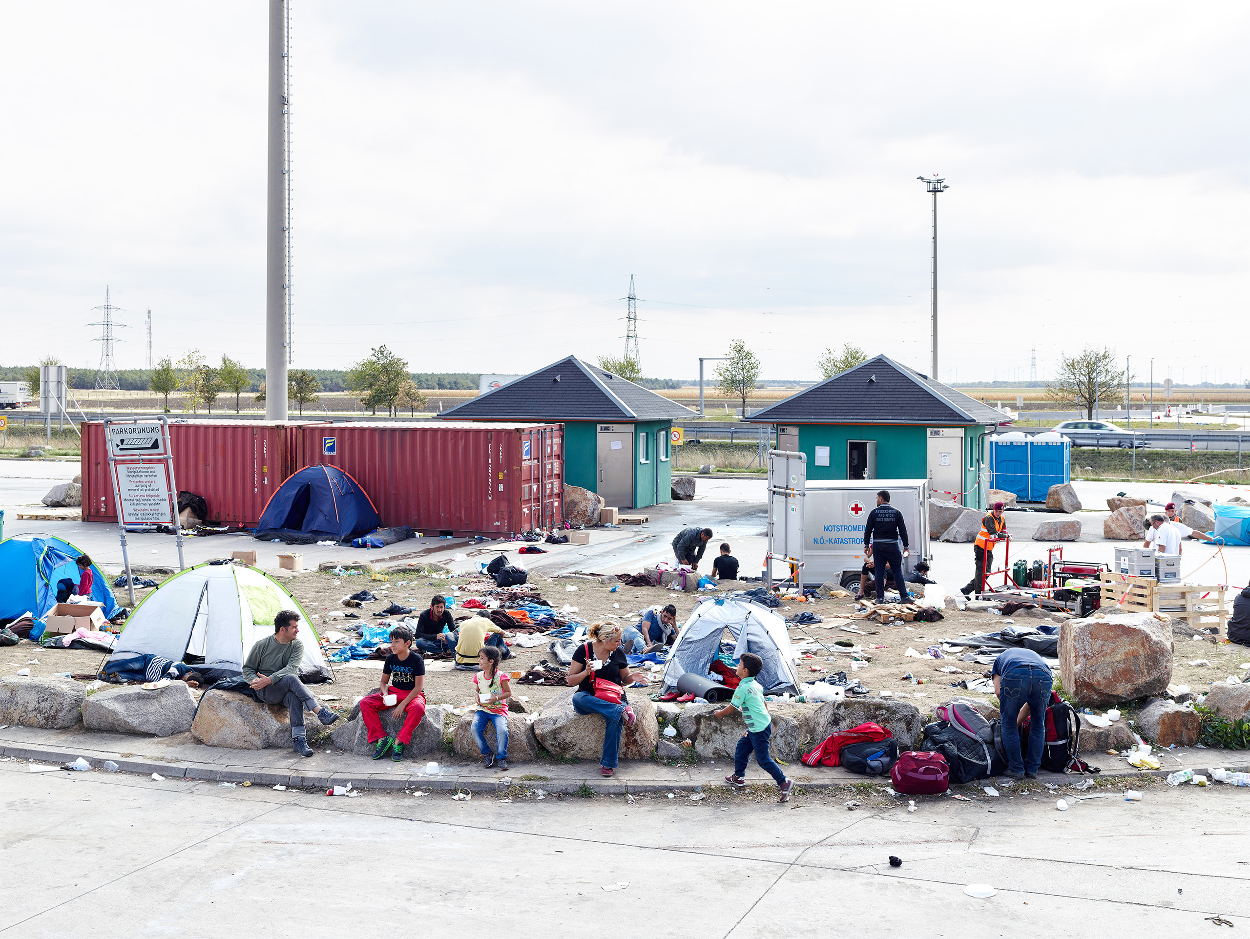 Refugees wait in Nickelsdorf, Austria, on the Hungarian border, a major entry point for migrants from the Middle East.
