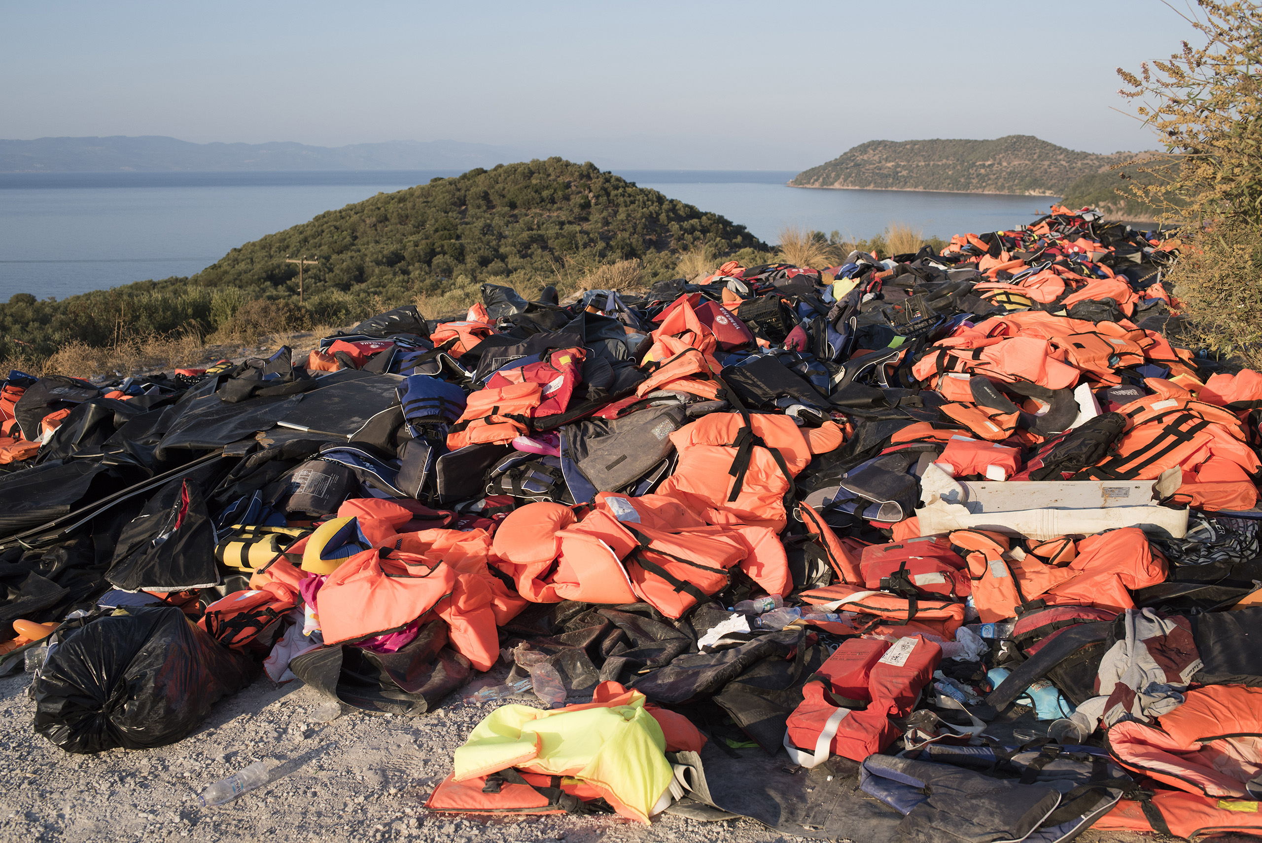 A beach  on the Greek island of Lesbos is festooned with orange life jackets and deflated rafts abandoned by migrants who are coming ashore near the village of Skala Sikamineas after navigating the 6-mile crossing from Turkey on  inflatable rafts.  Between 2,000 and 3,500 migrants now reach the island daily, riding on about 100 inflatable rafts. Sept., 2015.From  Witness the Resilience of Thousands of Refugees on Their Way to Europe
