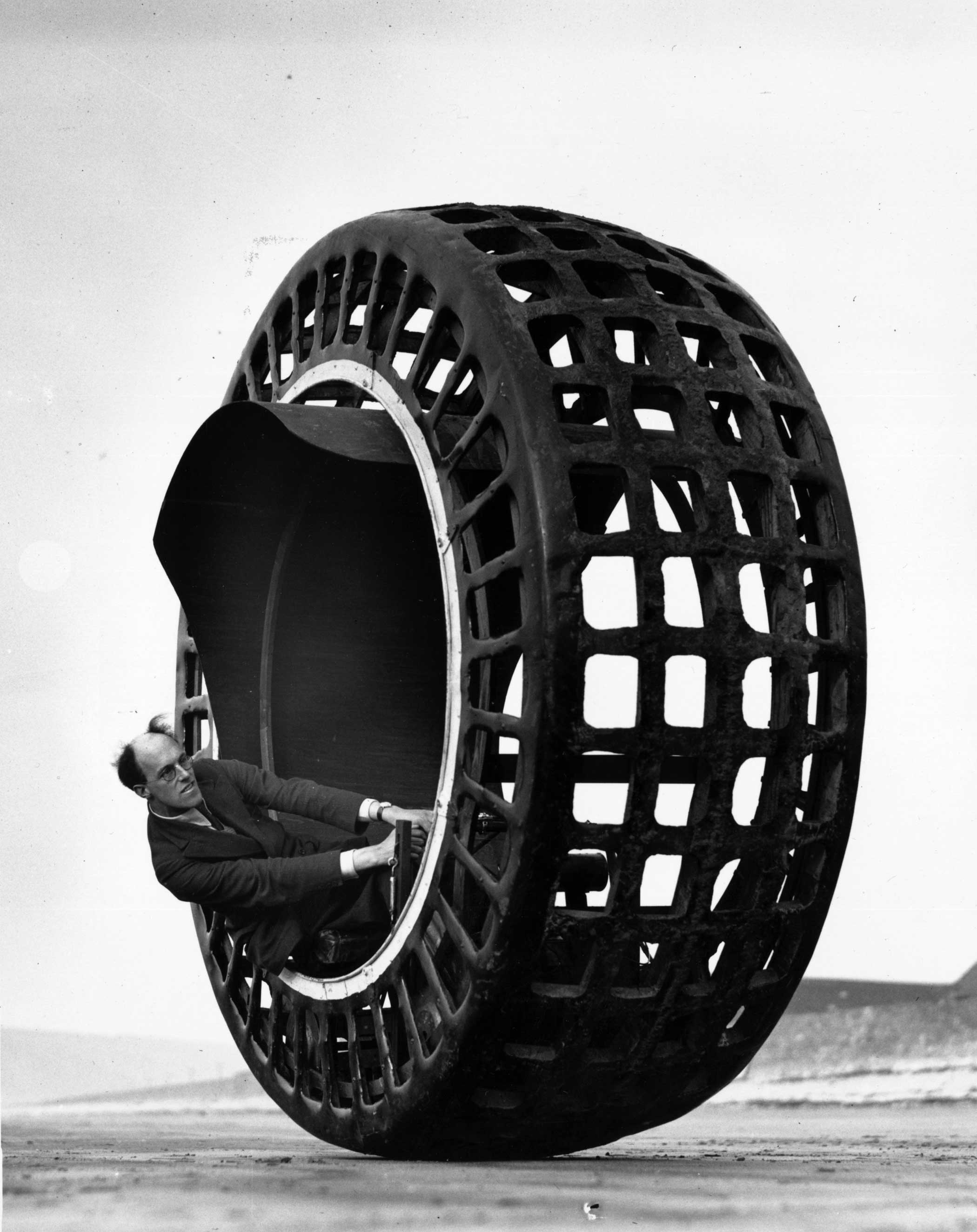 The Dynasphere, an electrically-driven wheel, capable of speeds of 30mph, being tested on the beach at Weston Super Mare by Mr J. A. Purves of Taunton, who invented the machine with his son.