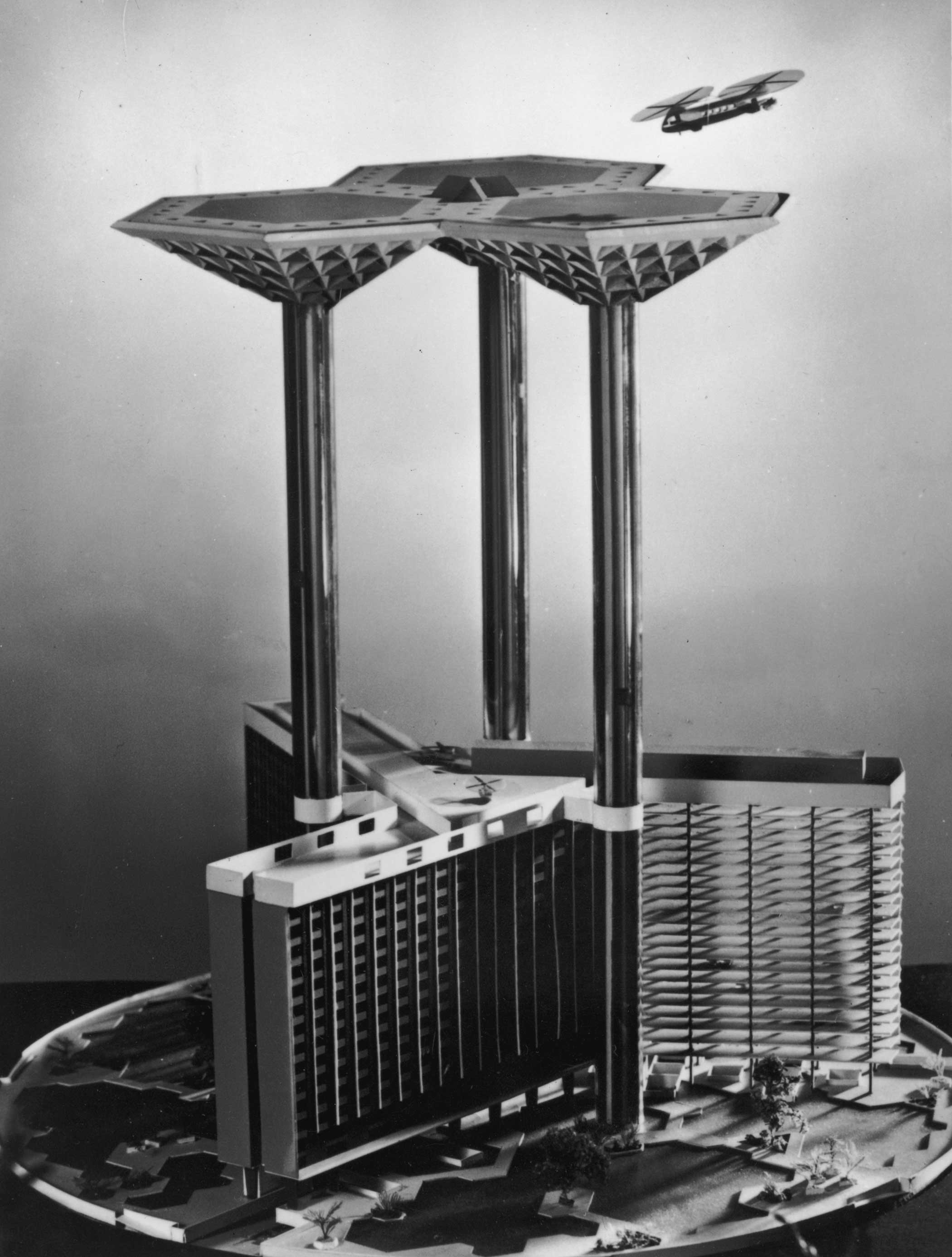 Architect James Dartford designed this model of 'Skyport 2000', a futuristic proposal for an airport in the year 2000. The model shows how aircraft could land and take off from a giant platform supported by three glass-clad pillars. These would contain lifts carrying passengers down to a hotel, offices, and parking for private planes and cars.