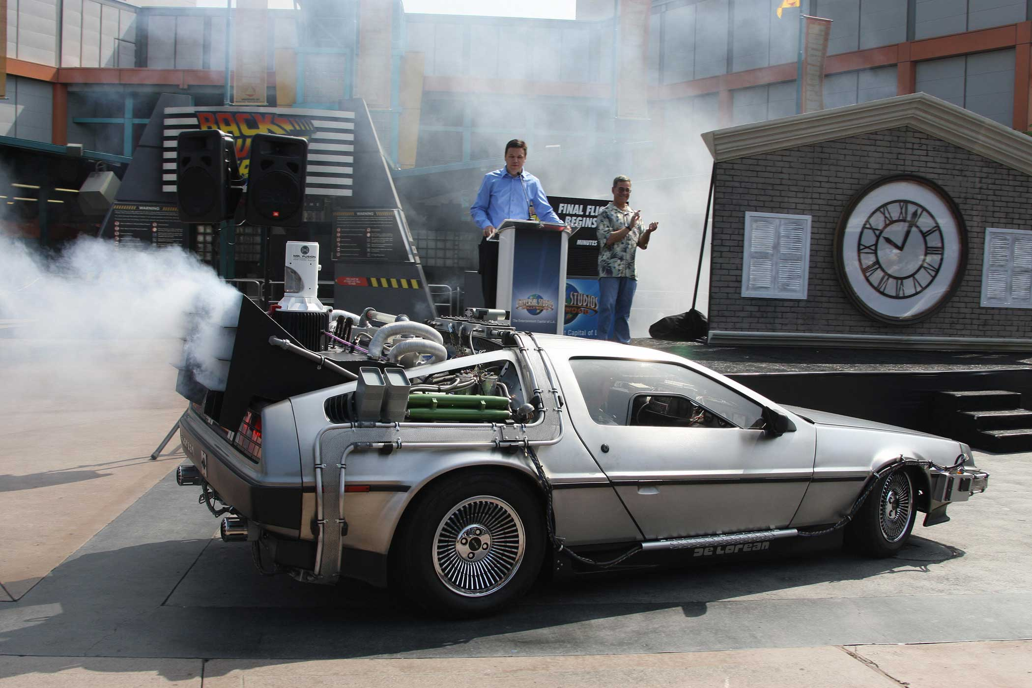 Actor Christopher Lloyd (in passenger seat) arrives in a DeLorean car at Universal Studios Hollywood's  Back to the Future - The Ride  in University City, California on Aug. 7, 2007.  Lloyd, who portrayed Doc Brown in the 1985 film  Back to the Future,  made the appearence to mark a month-long countdown to the closure of the 14-year-old ride.