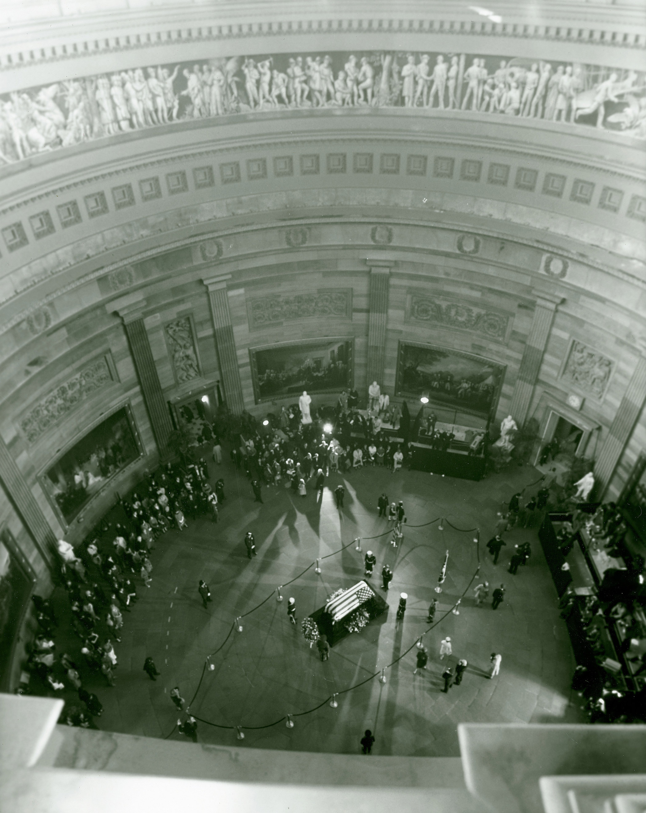 An aerial view from the visitors gallery inside the Capitol Rotunda shows the  casket and catafalque of John F. Kennedy lying in state on Nov. 25, 1963.