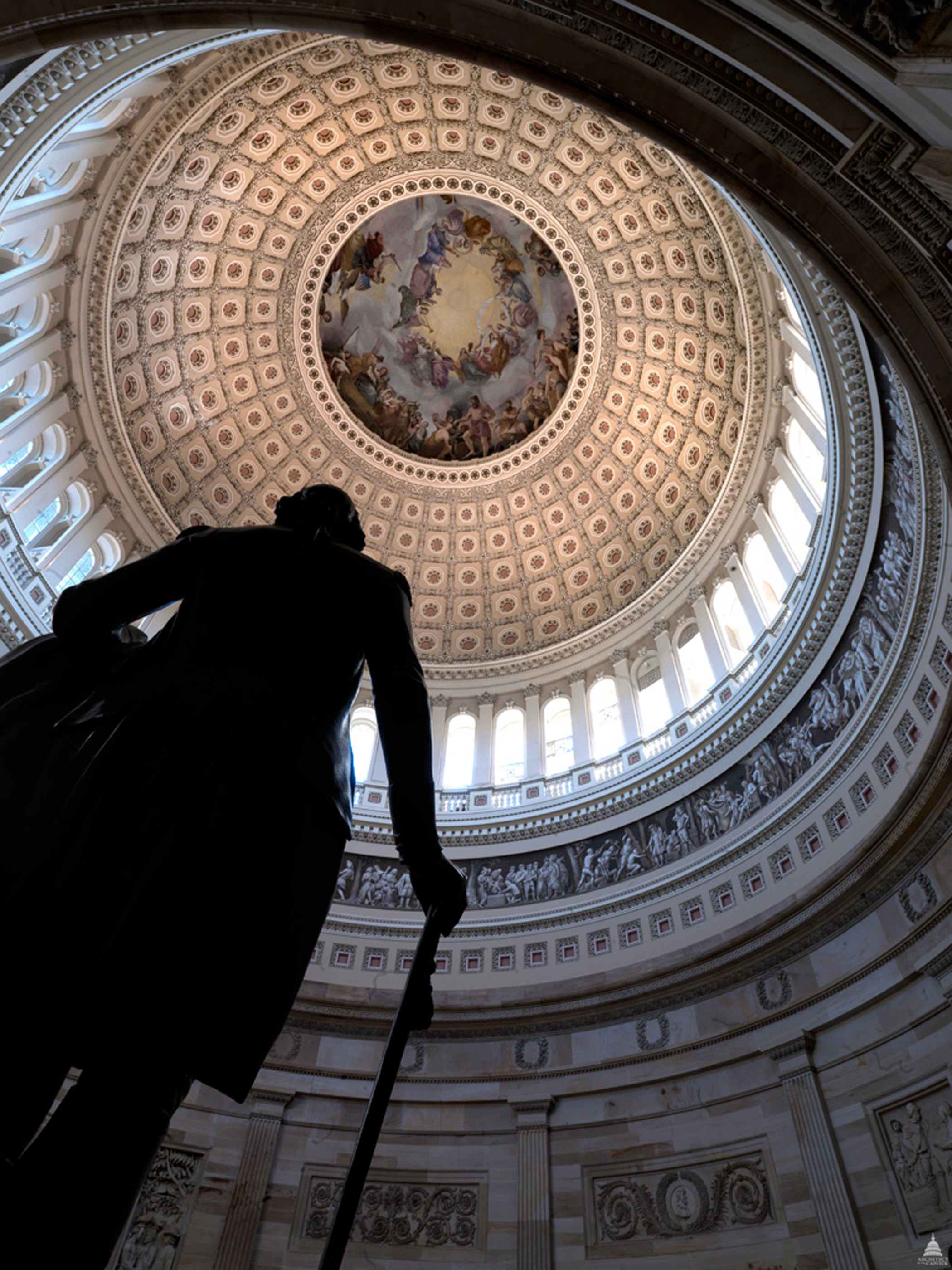 A view from the statue of George Washington in the Rotunda of the U.S. Capitol Building, showing Constantino Brumidi's fresco The Apotheosis of Washington.