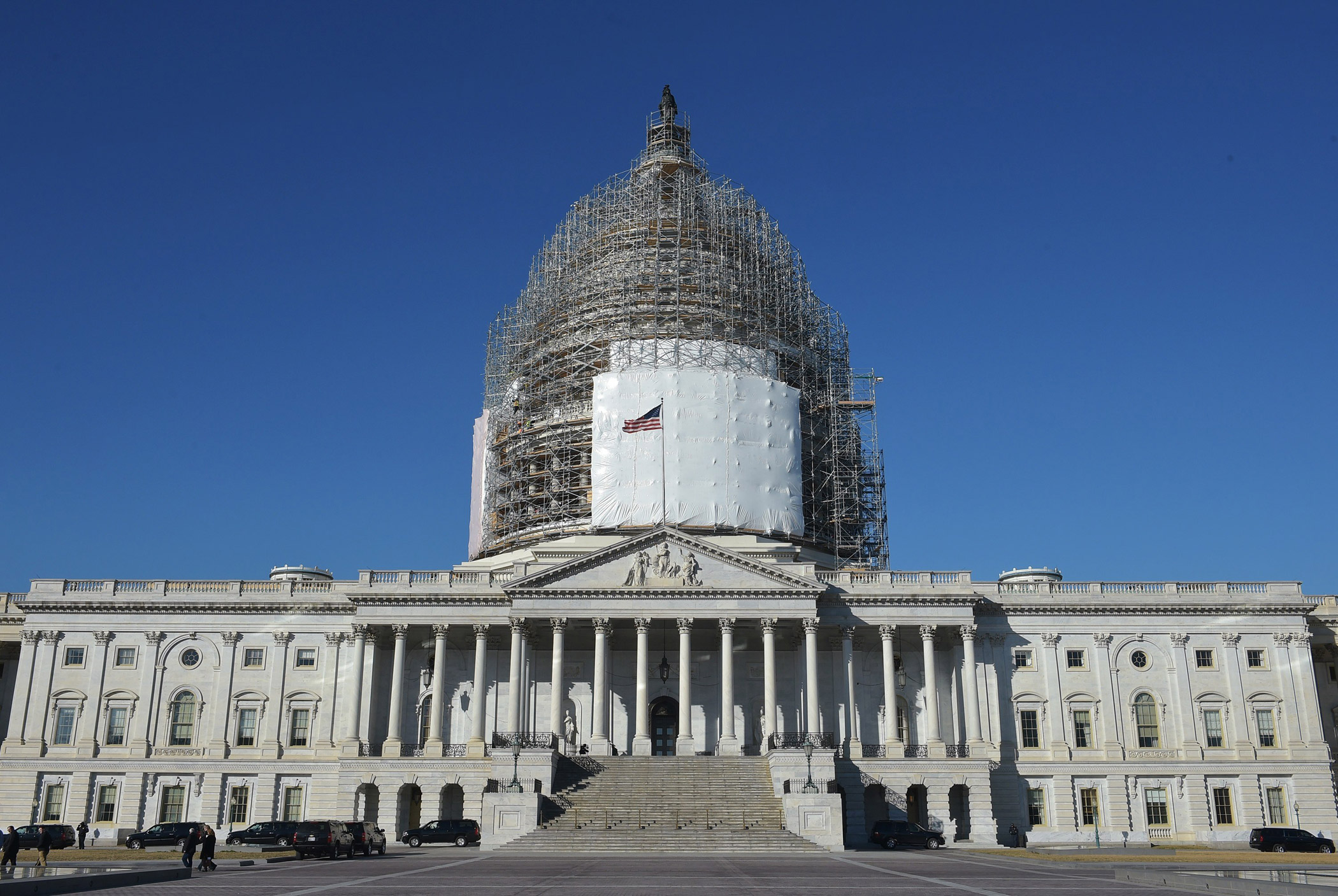 The U.S. Capitol dome, encased in scaffolding, is undergoing renovation in 2015.