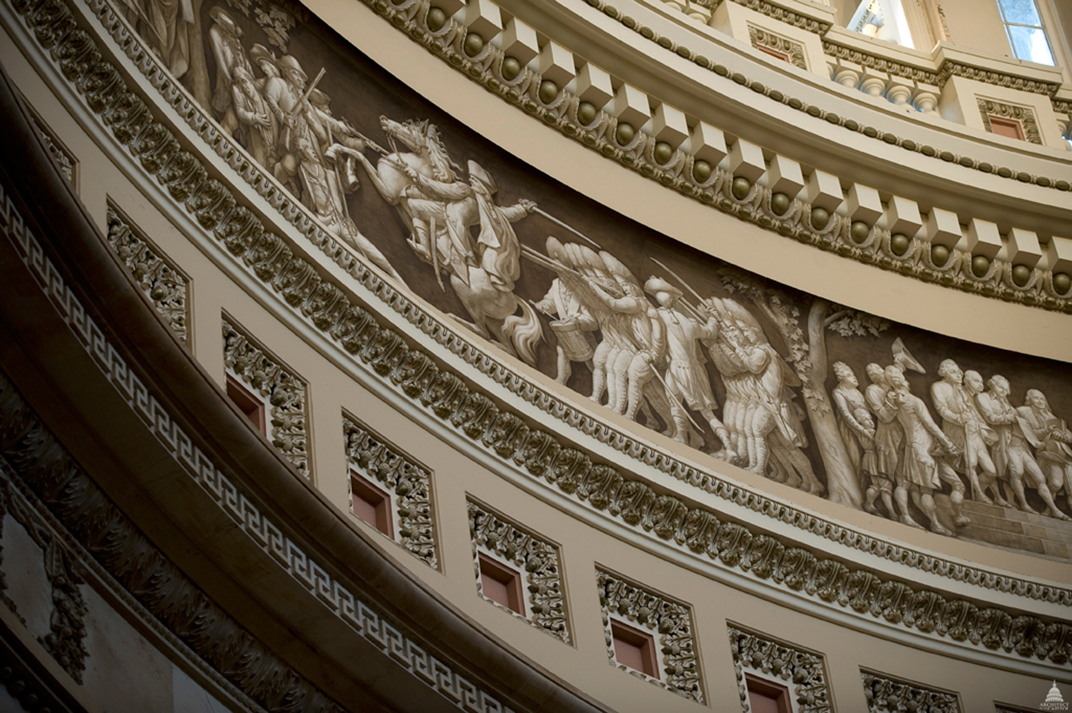 The Frieze of American History in the Rotunda of the United States Capitol, seen circa 2011, contains a painted panorama depicting significant events in American history. The frieze's 19 scenes is the work of three artists: Constantino Brumidi, Filippo Constaggini and Allyn Cox.