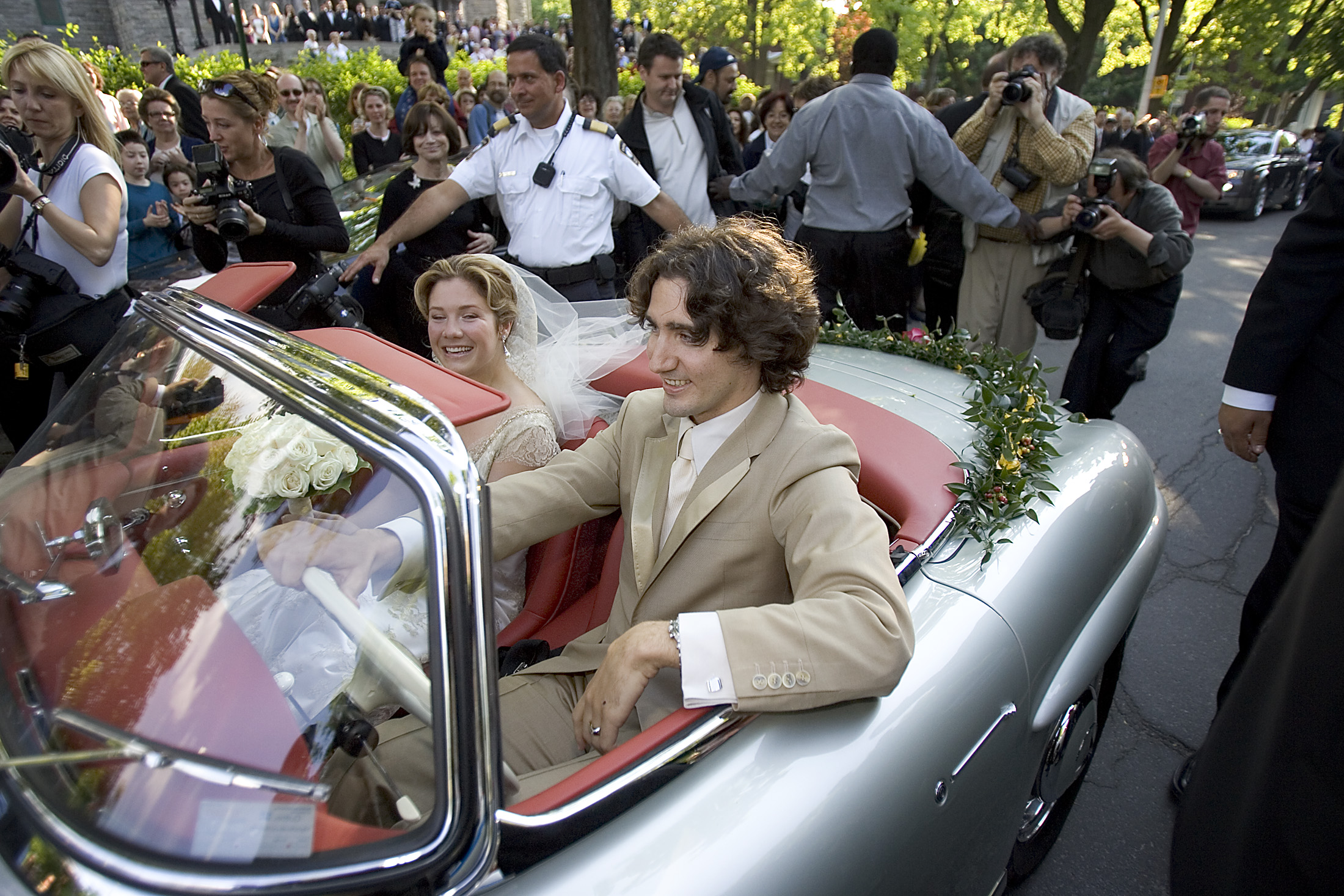 Justin Trudeau and Sophie Gregoire leave following their wedding ceremony in his father's 1959 Mercedes 300SL in Montreal, in 2005.