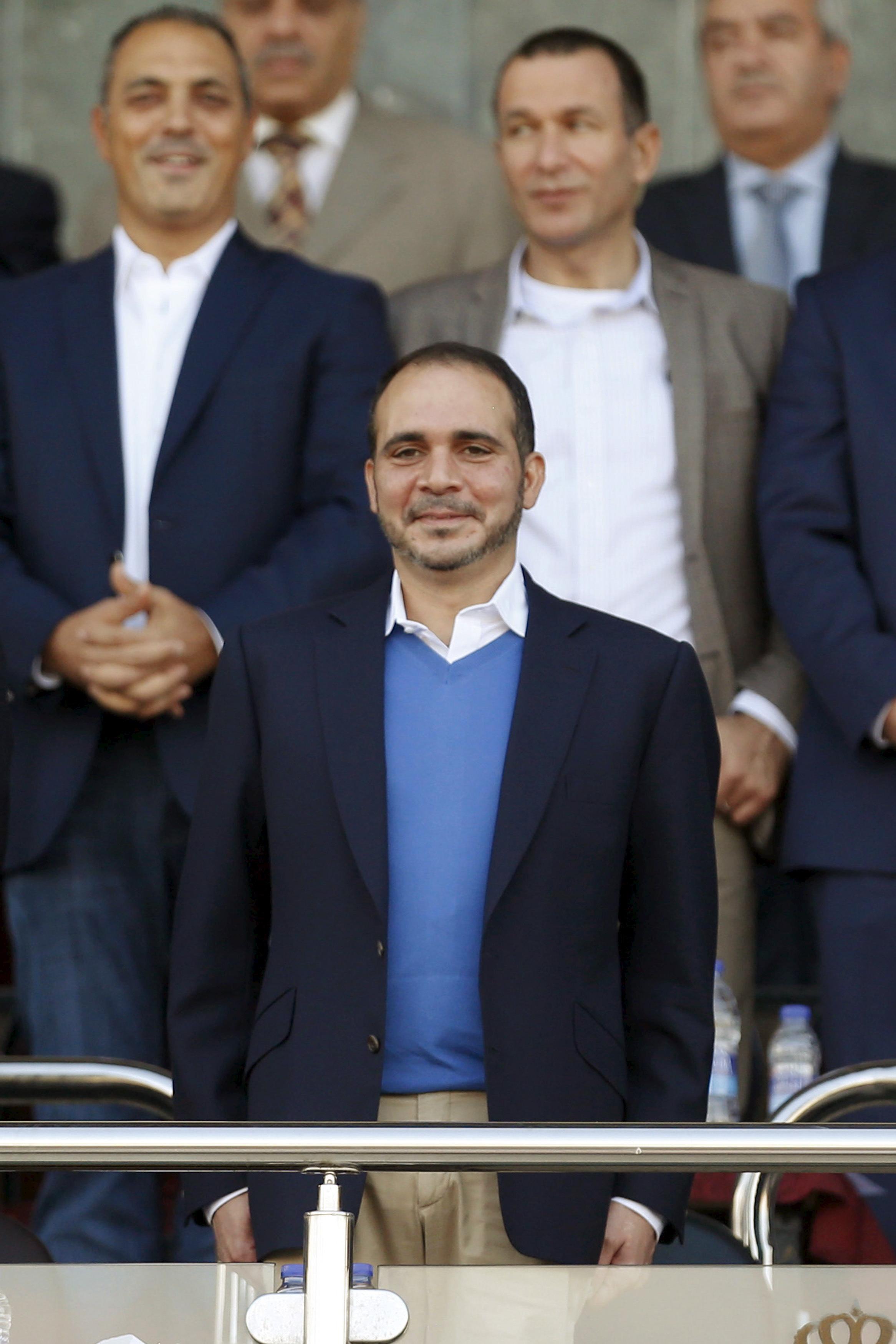 Jordanian Prince Ali bin Al Hussein (C) attends the 2018 World Cup qualifying soccer match between Jordan and Australia at the Amman International Stadium in Amman, Jordan October 8, 2015.