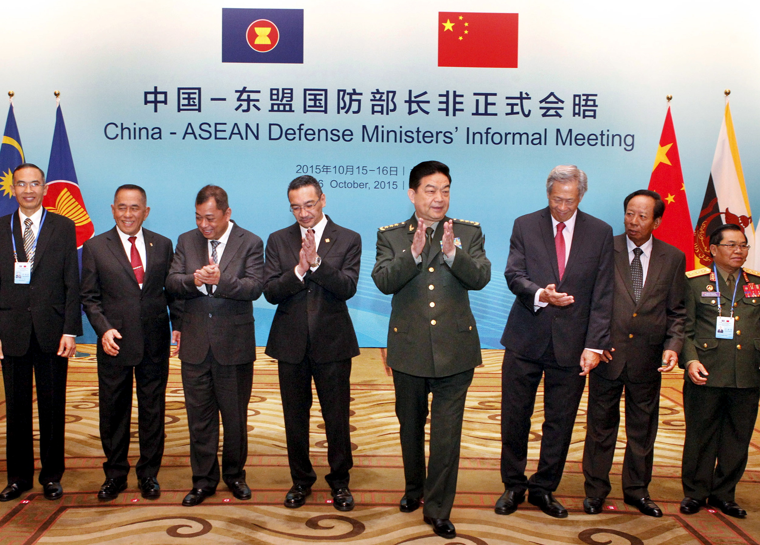 Chinese Defense Minister Chang Wanquan (fourth from right) claps next to his counterparts from the Southeast Asian Nations (ASEAN) during the China-ASEAN Defense Ministers' Informal Meeting in Beijing, China, October 16, 2015.