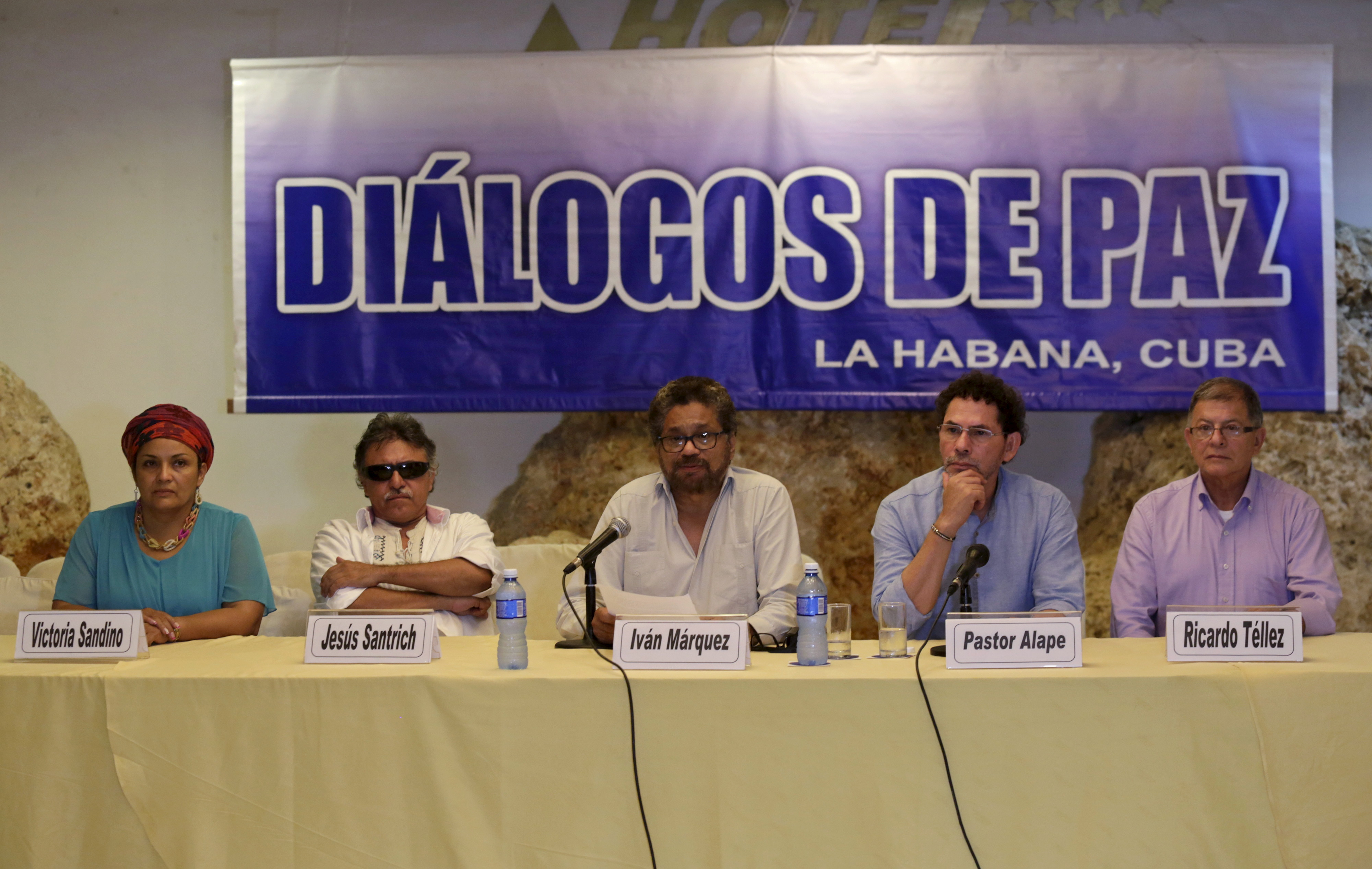 Revolutionary Armed Forces of Colombia (FARC) lead negotiator Iván Márquez, center, reads a document while flanked by fellow FARC members in Havana on Oct. 17, 2015