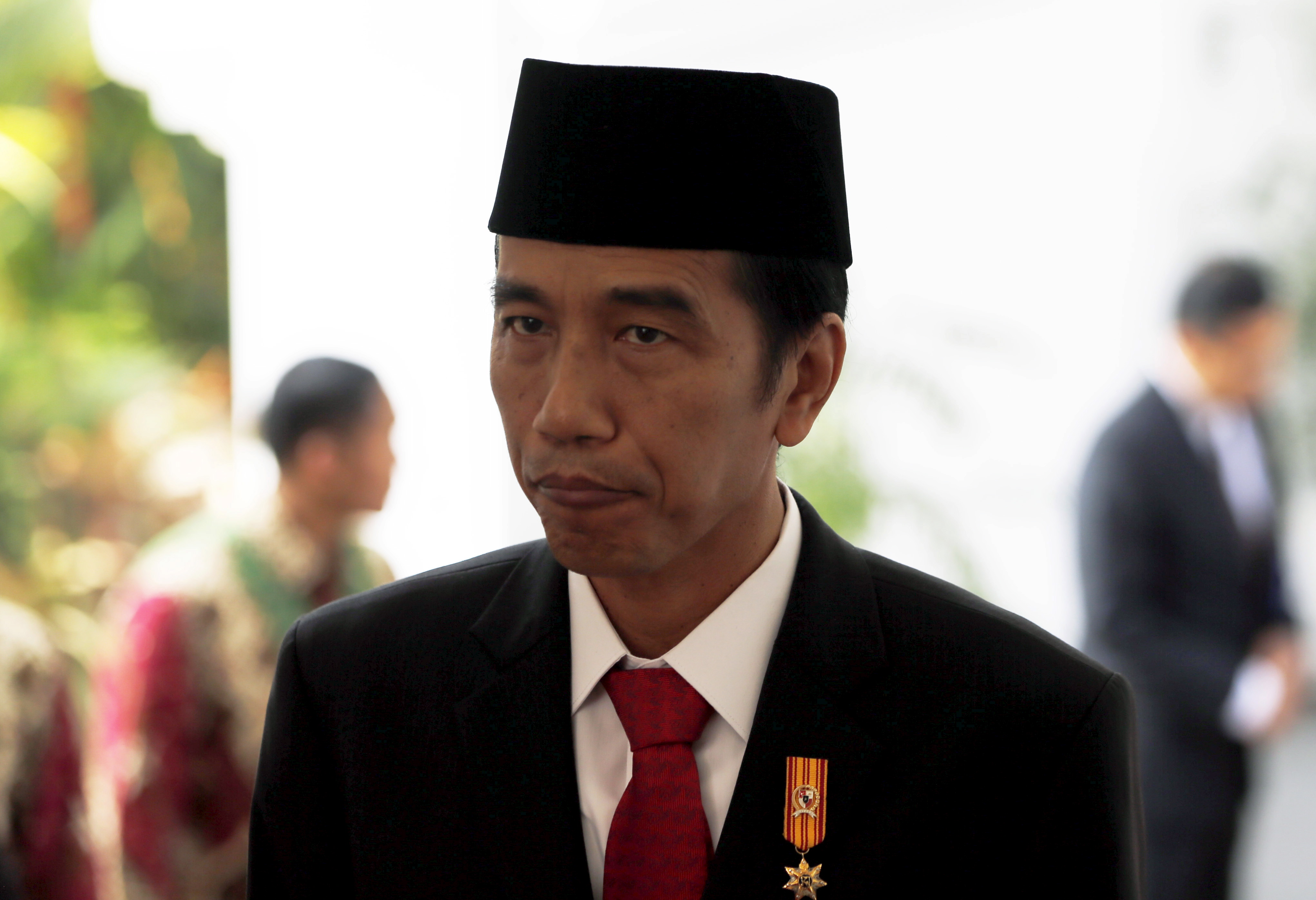 Indonesian President Joko Widodo is pictured after seeing off Danish Queen Margarethe at the presidential palace in Jakarta on Oct. 22, 2015