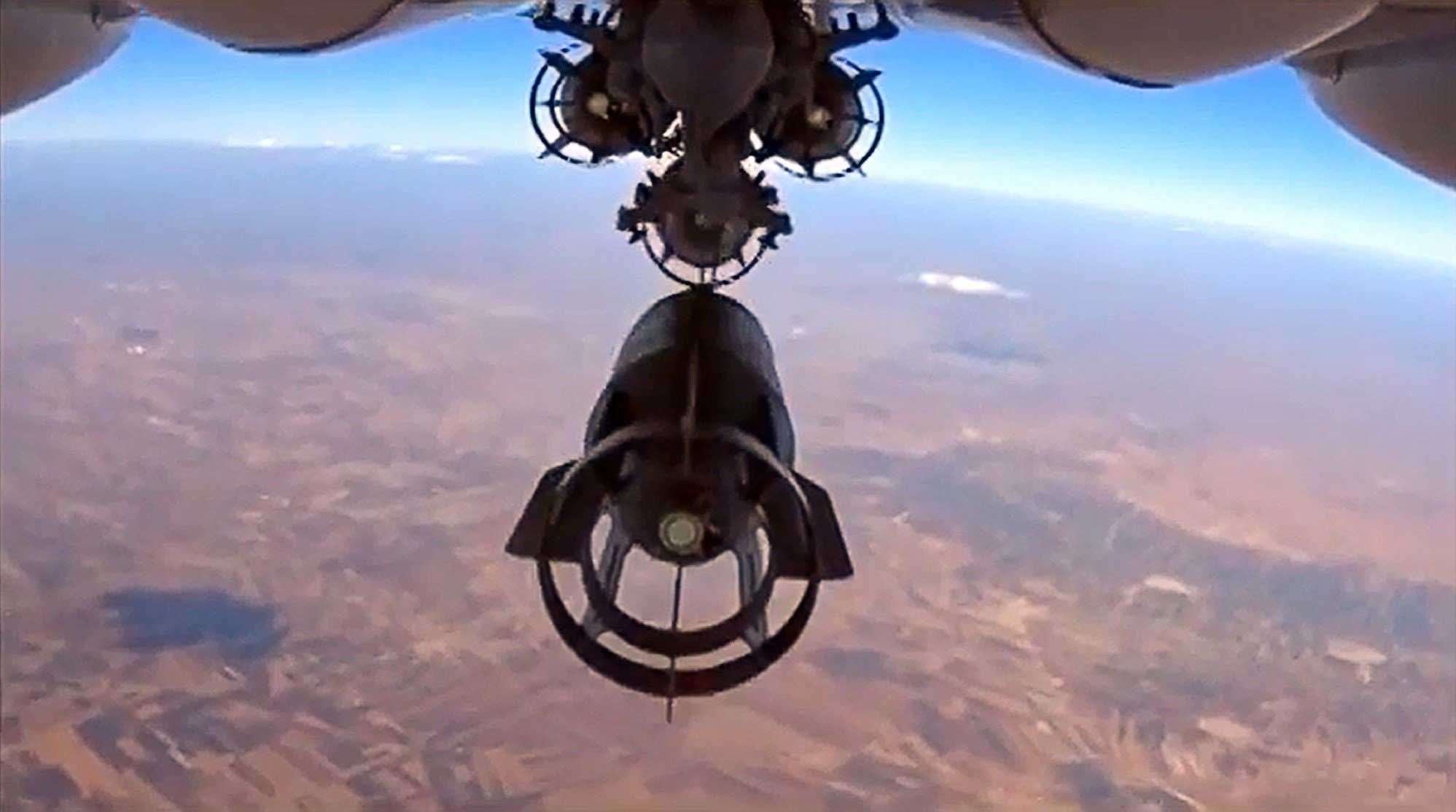 A video grab made on Oct. 6, 2015, shows an image taken from footage made available on the Russian Defense Ministry's official website on Oct. 5, purporting to show a Russia's Su-24M bomber dropping bombs during an airstrike in Syria.