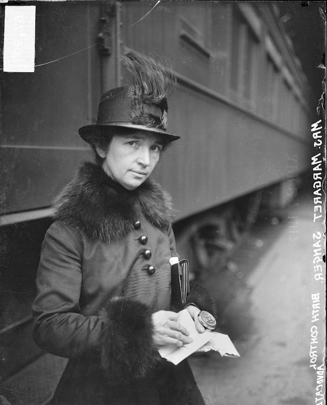 American birth control activist Margaret Sanger (1879 - 1966) standing in a train station in Chicago, 1917.