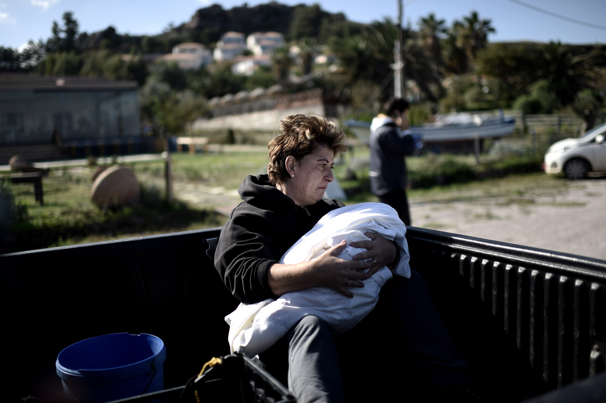A woman holds the body of a dead baby that was found on the beach on the Greek island of Lesbos on Oct. 30, 2015.