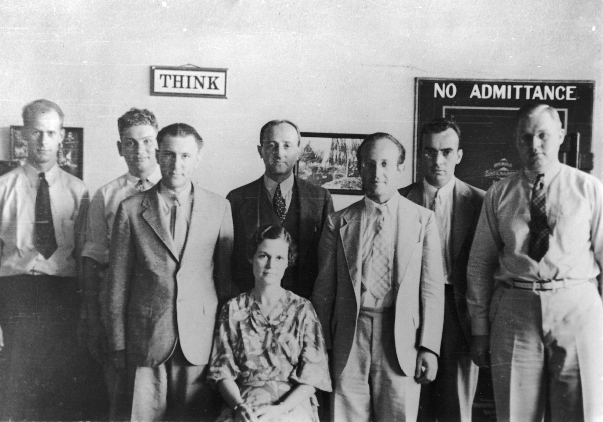 Portrait of members of the US Army's Signals Intelligence Service, mid 1930s. Pictured are, from left, Herrick F. Bearce, Dr Solomon Kullback (1907 - 1994), US Army Captain Harold G. Miller (also identified in some sources as Herrod G. Miller), department head William F. Friedman (1891 - 1969)(standing), Louise Newkirk Nelson (also identified as Anna Louise Newkirk)(sitting), Dr Abraham Sinkov (1907 - 1998), US Coast Guard lieutenant L.D. Jones (also identified as L.T. Jones), and Frank B. Rowlett (1908 - 1998).