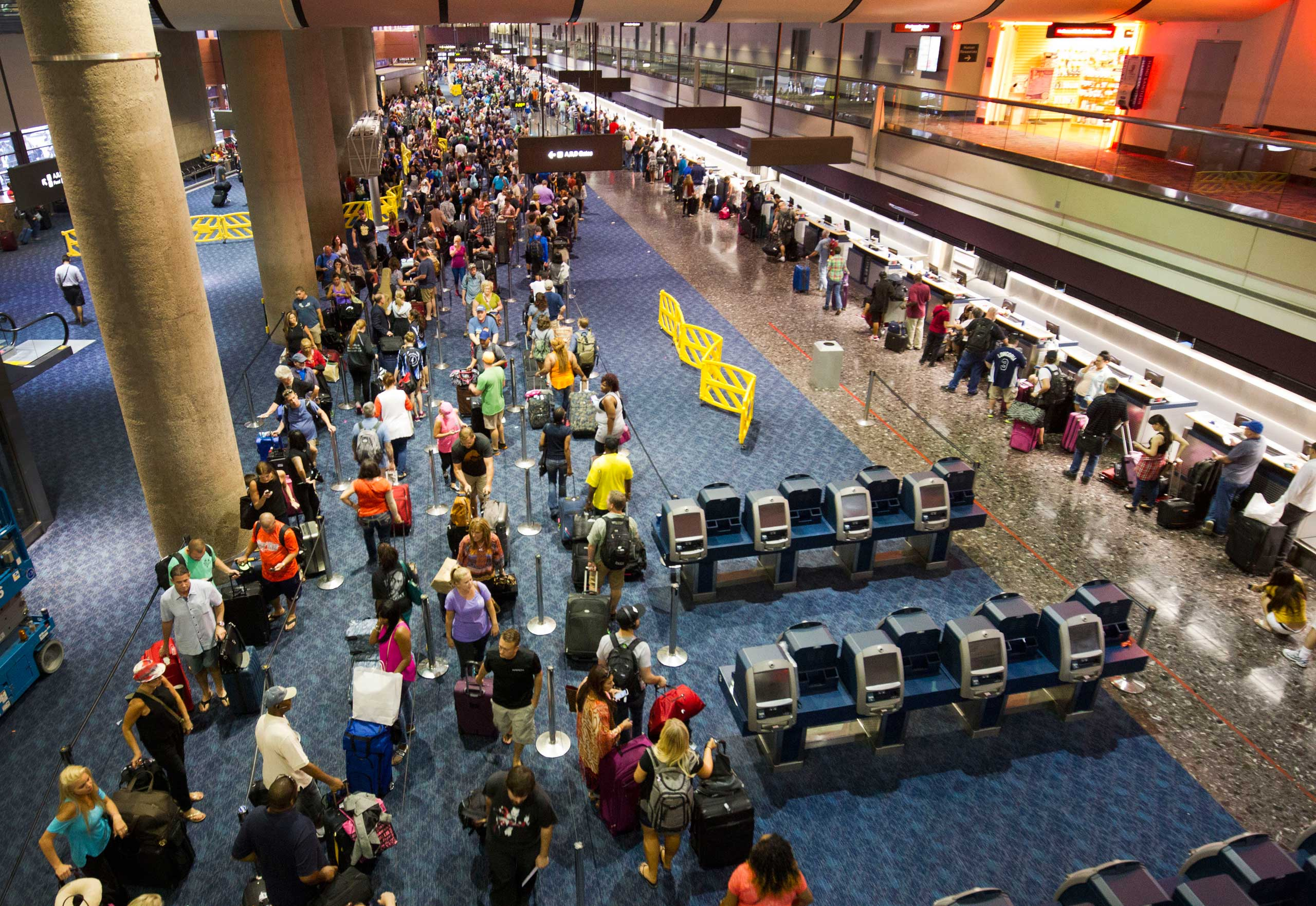 Departing Southwest Airlines passengers wait in line at McCarran International Airport in Las Vegas, Oct. 11, 2015.