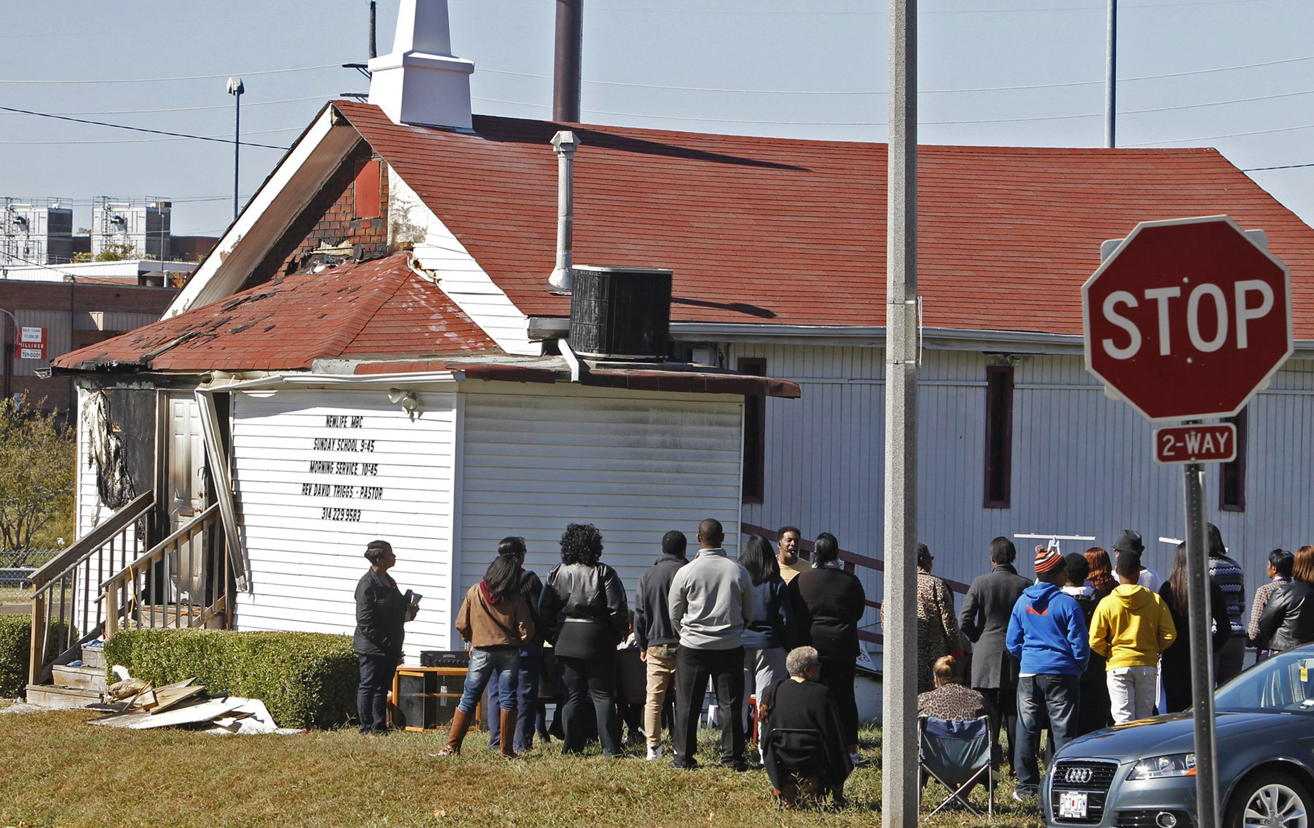An outdoor service is held following a fire at the New Life Missionary Baptist Church in St. Louis on Oct. 18, 2015.